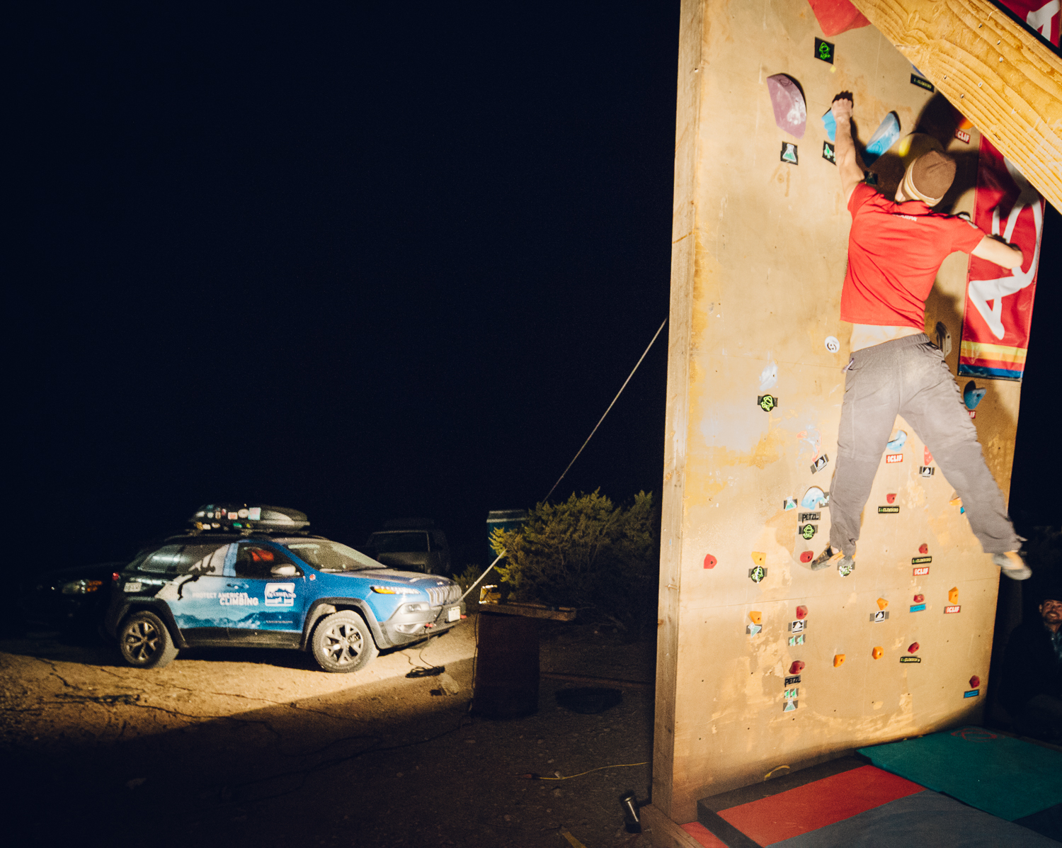 Access Fund's Conservation Team's JEEP is a rear anchor for the Dyno-Wall during the evening's competition. Michael Lim Photography 2015 ©
