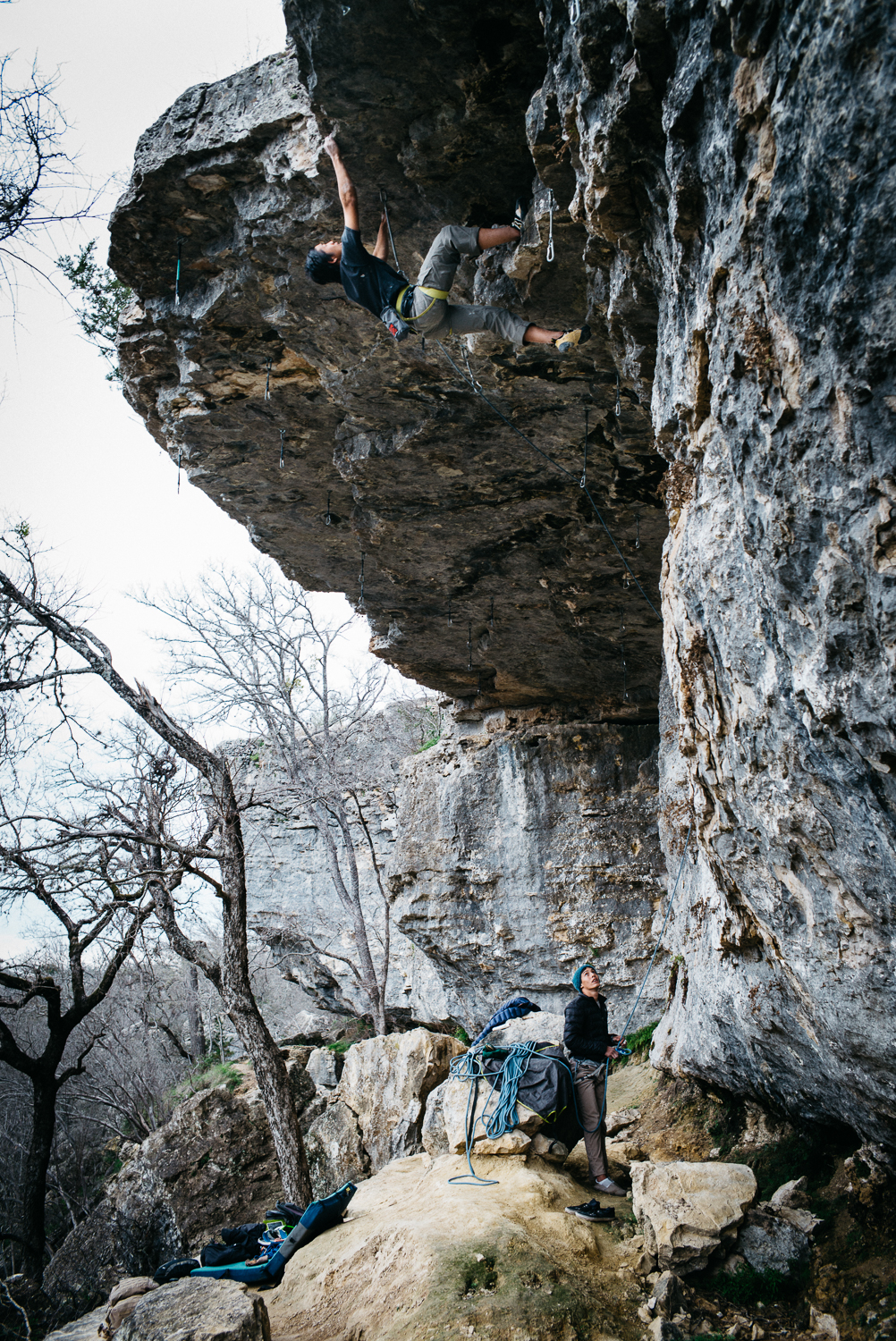 Ben pulling the lip on a short sport route at Reimer's Ranch Park along the North Bank.