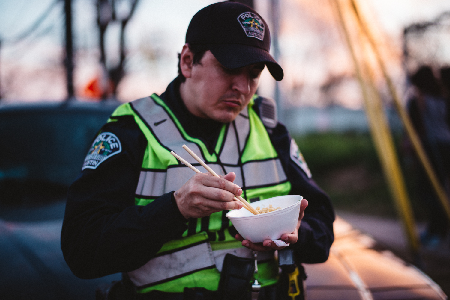 Police Officer Noodles Eating SXSW 2015 Michael Lim Photography Austin Texas