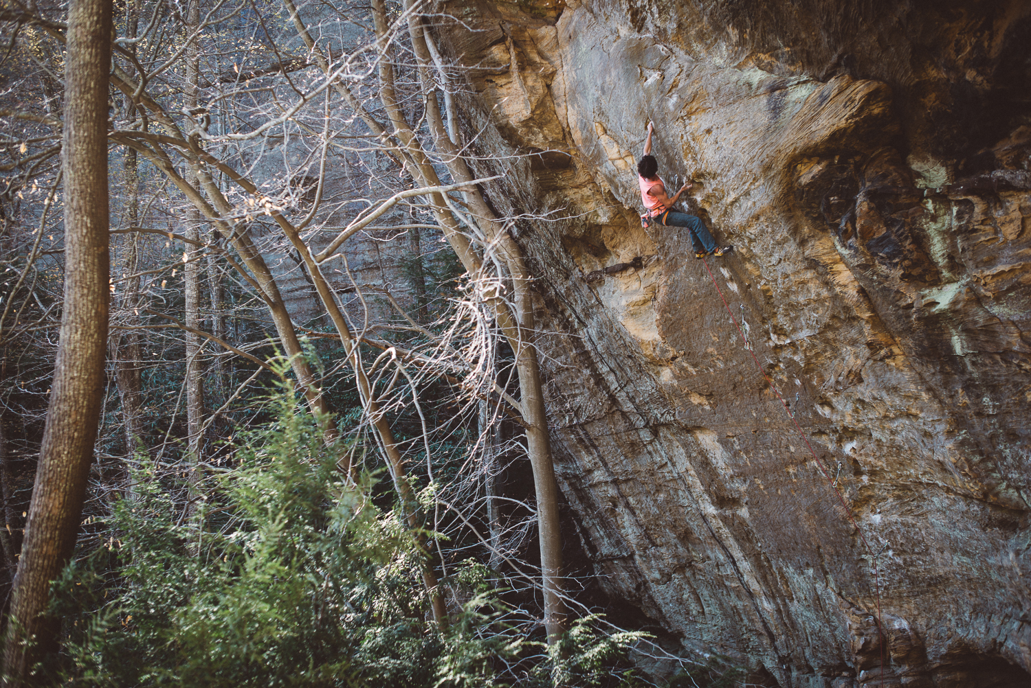 Brandon Leader pulling through the crux of Buttercup (5.13c), Red River Gorge.