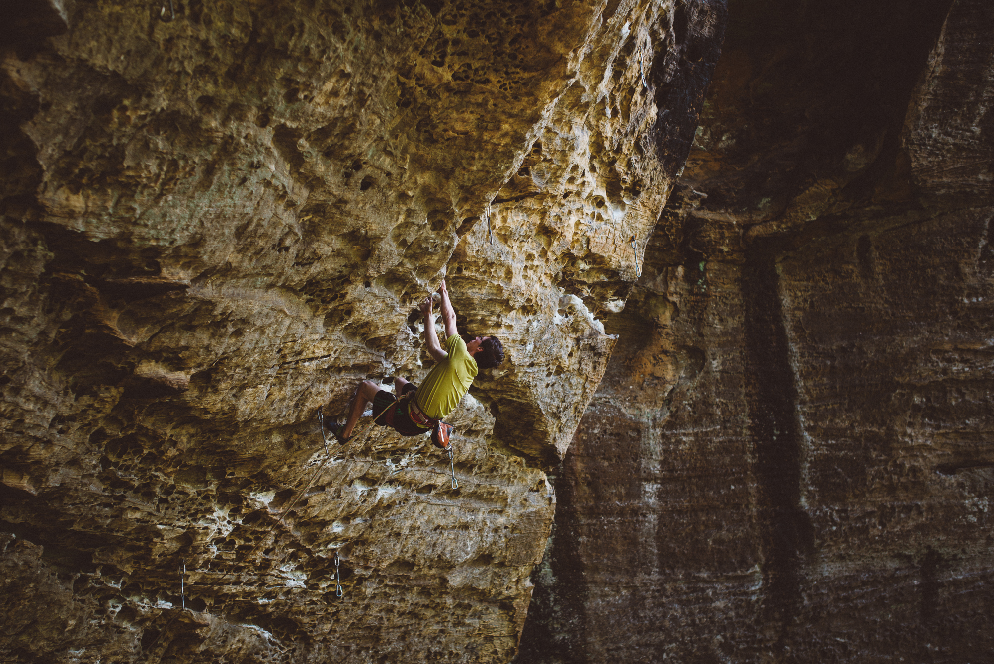 Dru Mack, sponsored by Canopy Crew, Rockhouse, and Evolve warming up on Beta-Vul Pipeline (5.12a) before heading over to Southern Smoke.