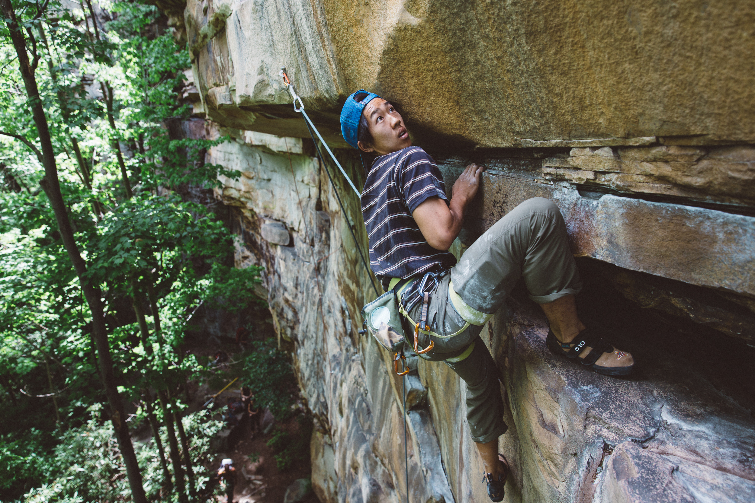 "Ben Lim playing around amongst the many ""techy"" climbs at the New River Gorge."