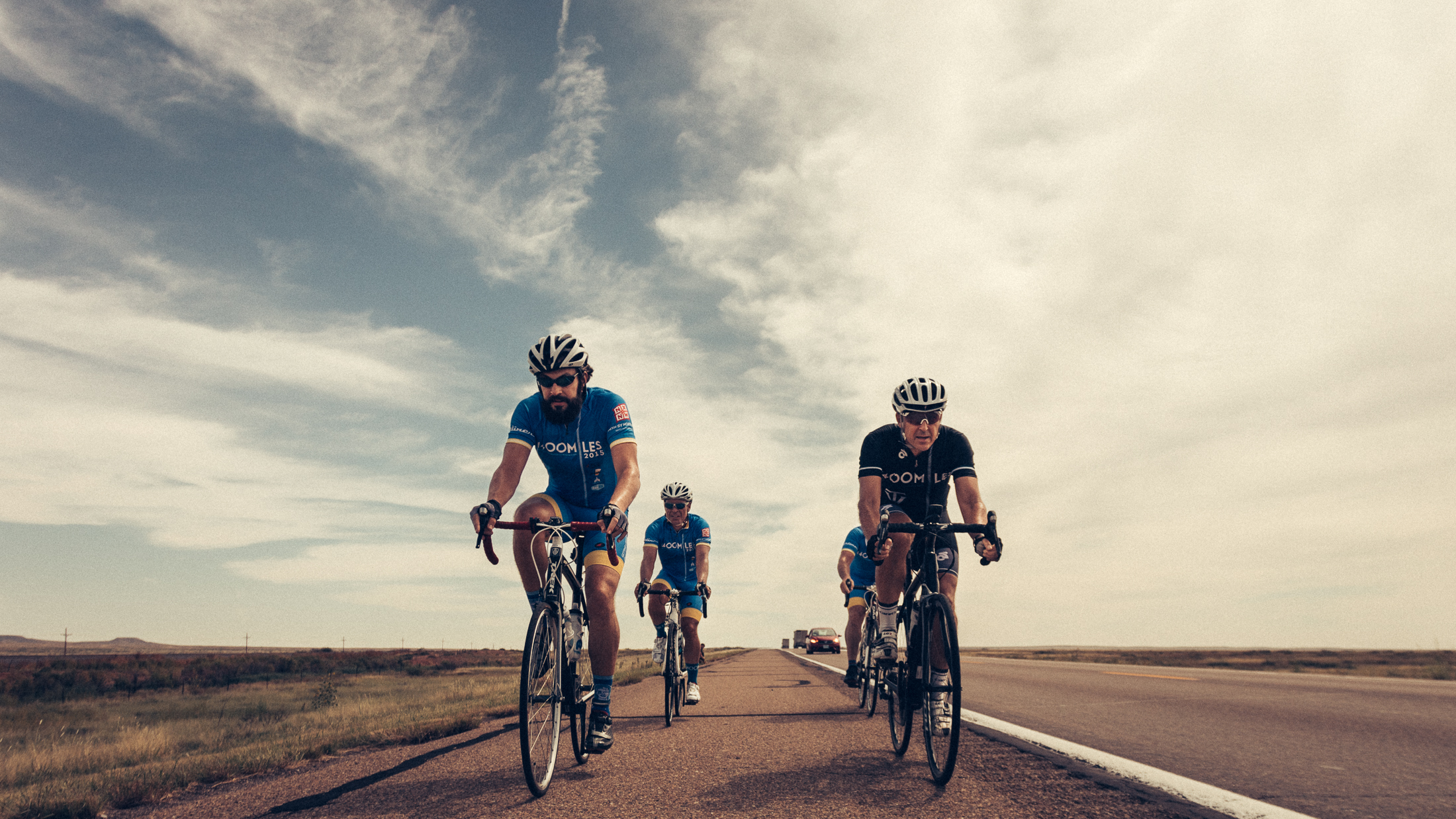 Riders for 1400 Miles cycling through north through New Mexico towards Colorado on a hot afternoon. Michael Lim Photography 2015 ©