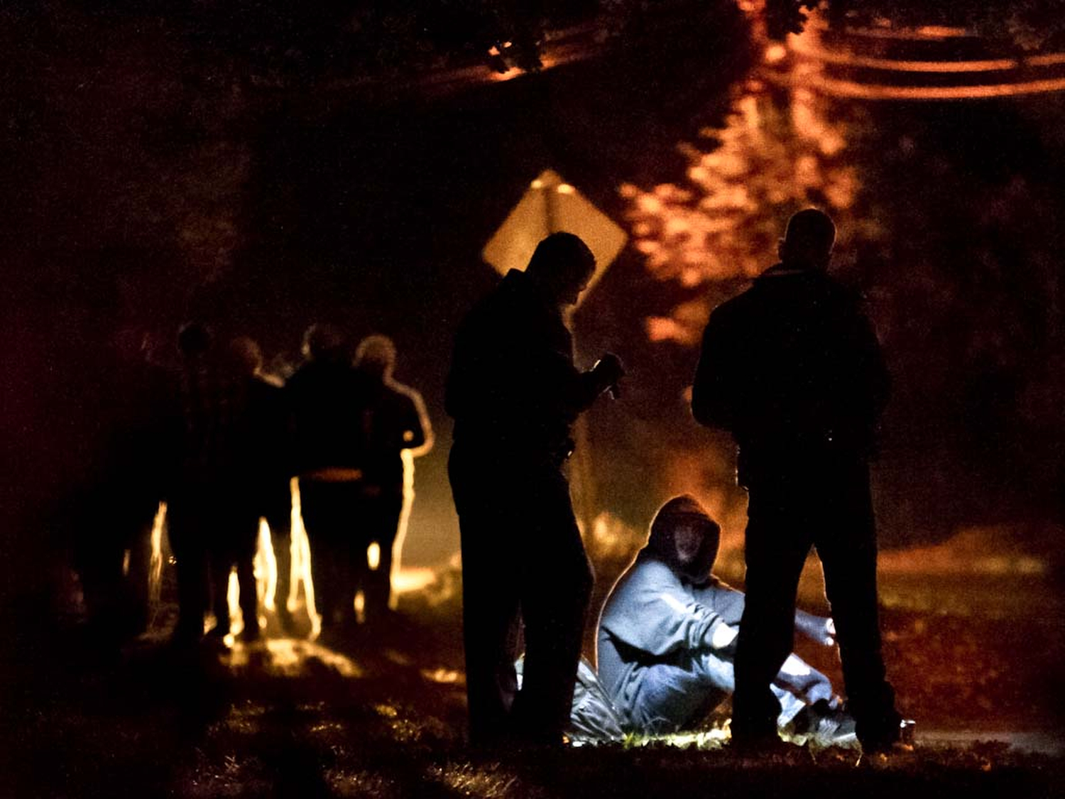 Police apprehend, search and question a UMASS Amherst student on his way to a party on Fearing Street in Amherst, Massachusetts. 2012