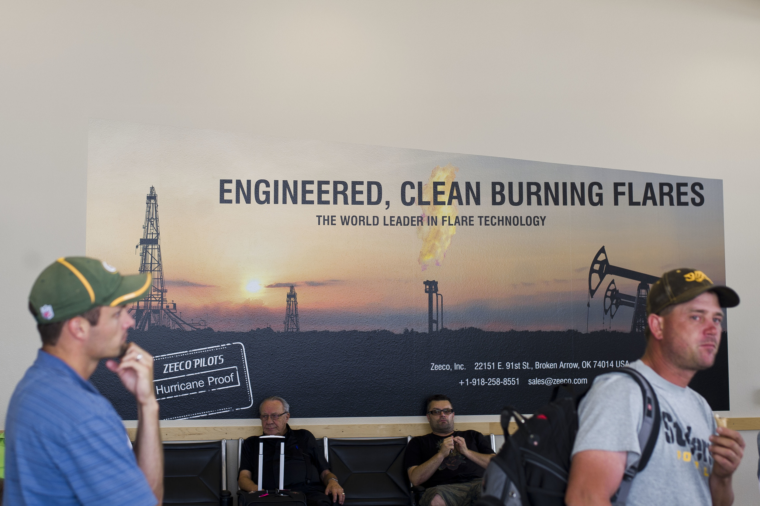 "Advertising for ""clean burning flares"" in the Bismarck International Airport, 2013. The state has since passed sweeping regulations to significantly decrease flared gas across the state."