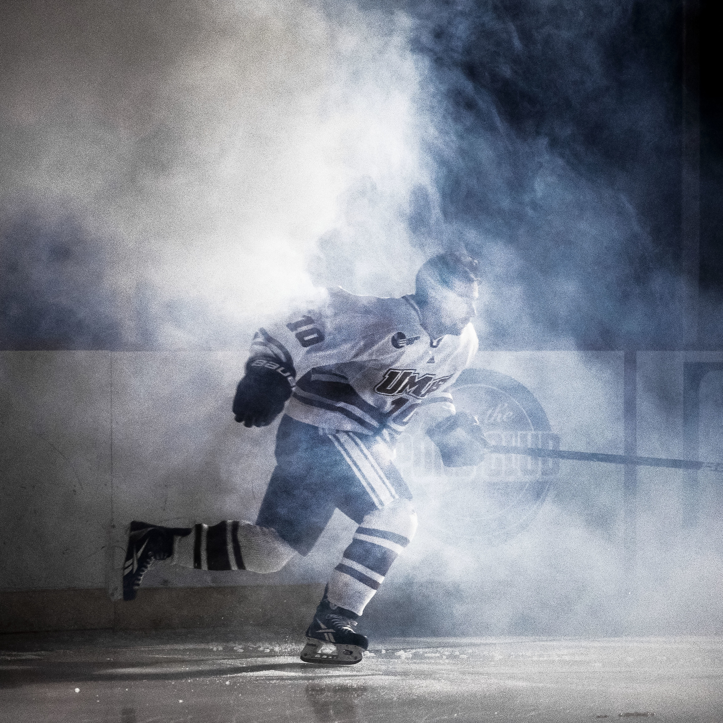 UMASS Amherst's Eric Filiou skates through ceremonial smoke before a game at the Mullins Center in Amherst, Massachusetts.