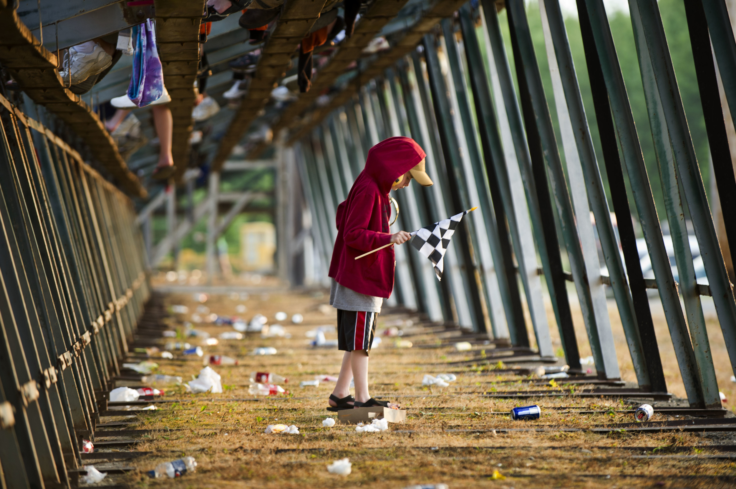 Ayden Haddad navigates through the garbage accumulated underneath the bleachers at Canandaigua Motorsports Park in Canandaigua, New York.
