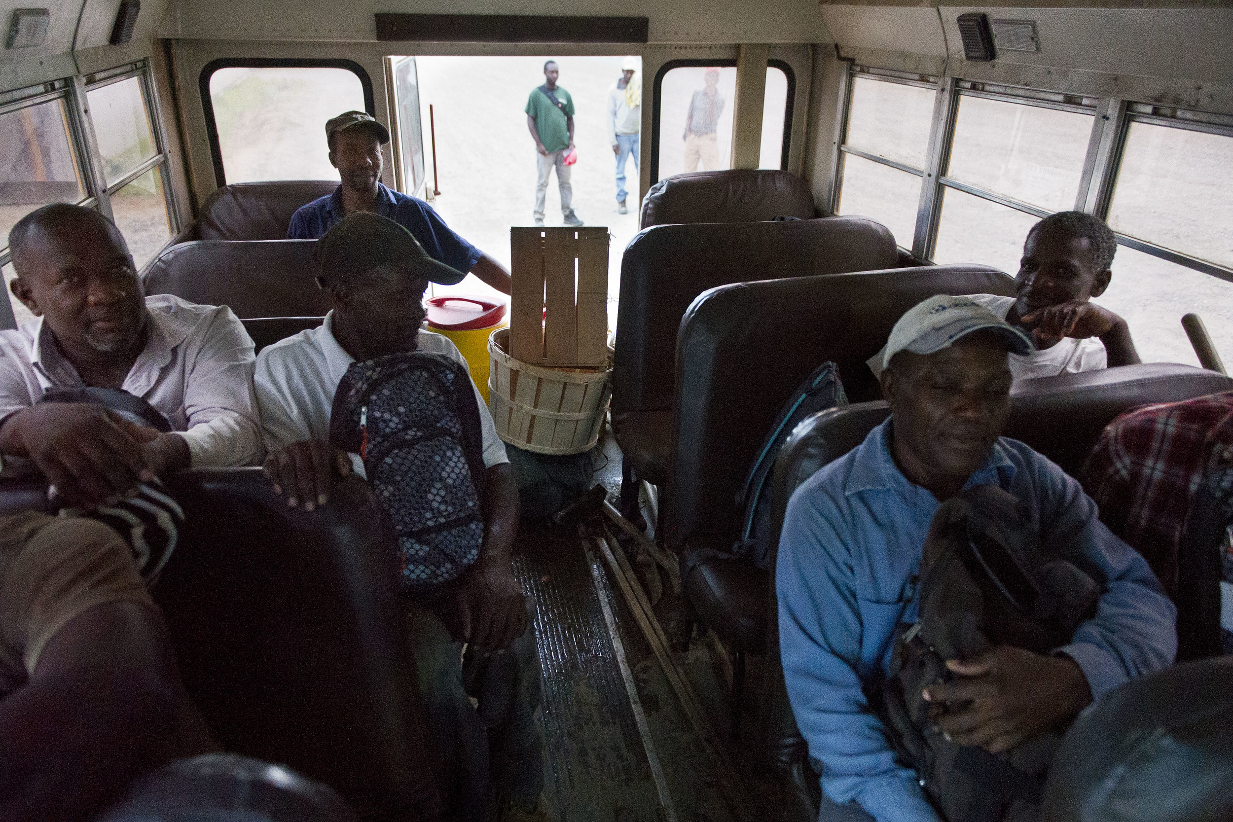 Western Massachusetts migrant workers wait to be bused to area farms for the work day.