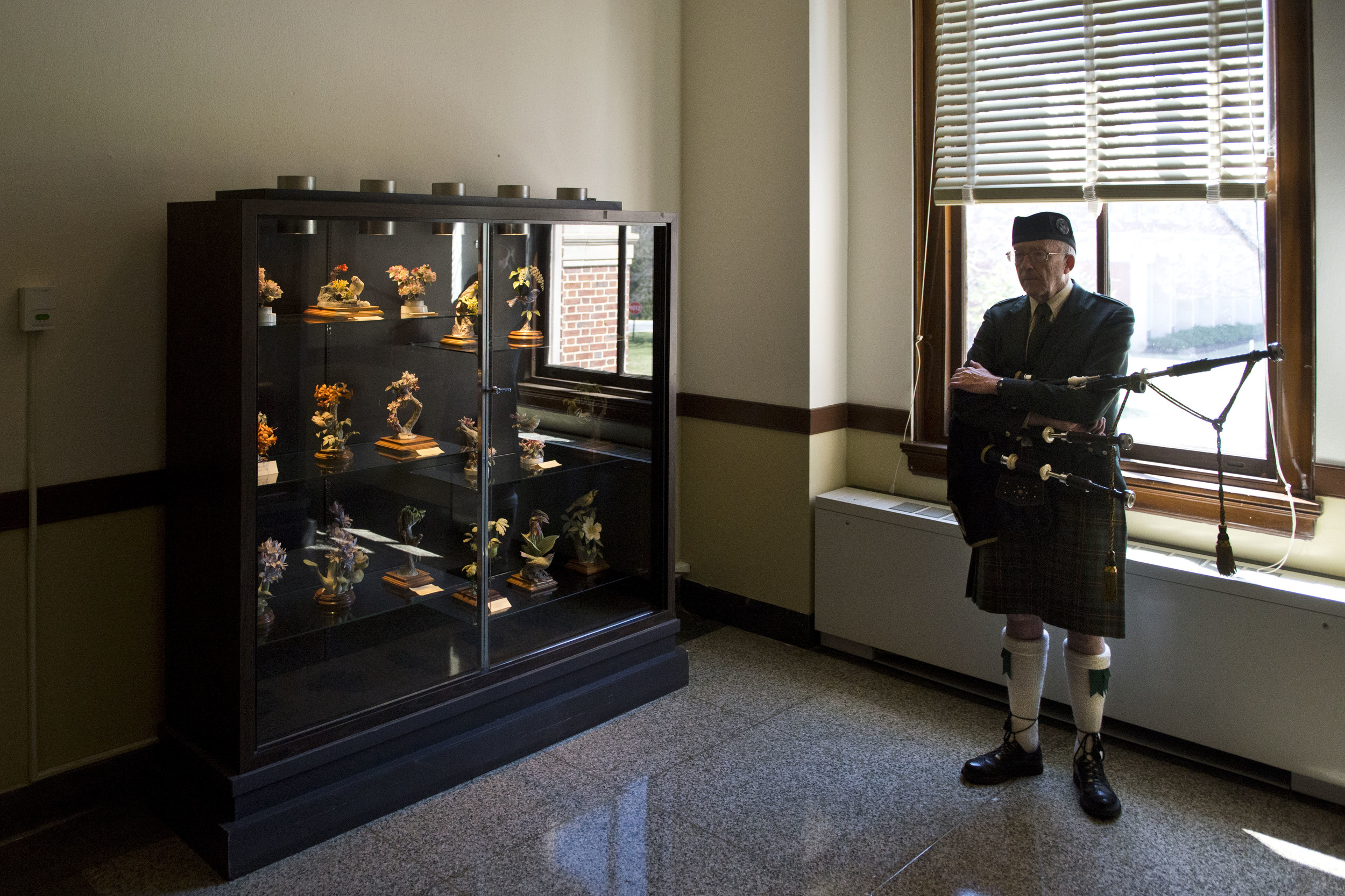 A bagpiper waits to play in the procession at the Notre Dame of Maryland University commencement ceremony.