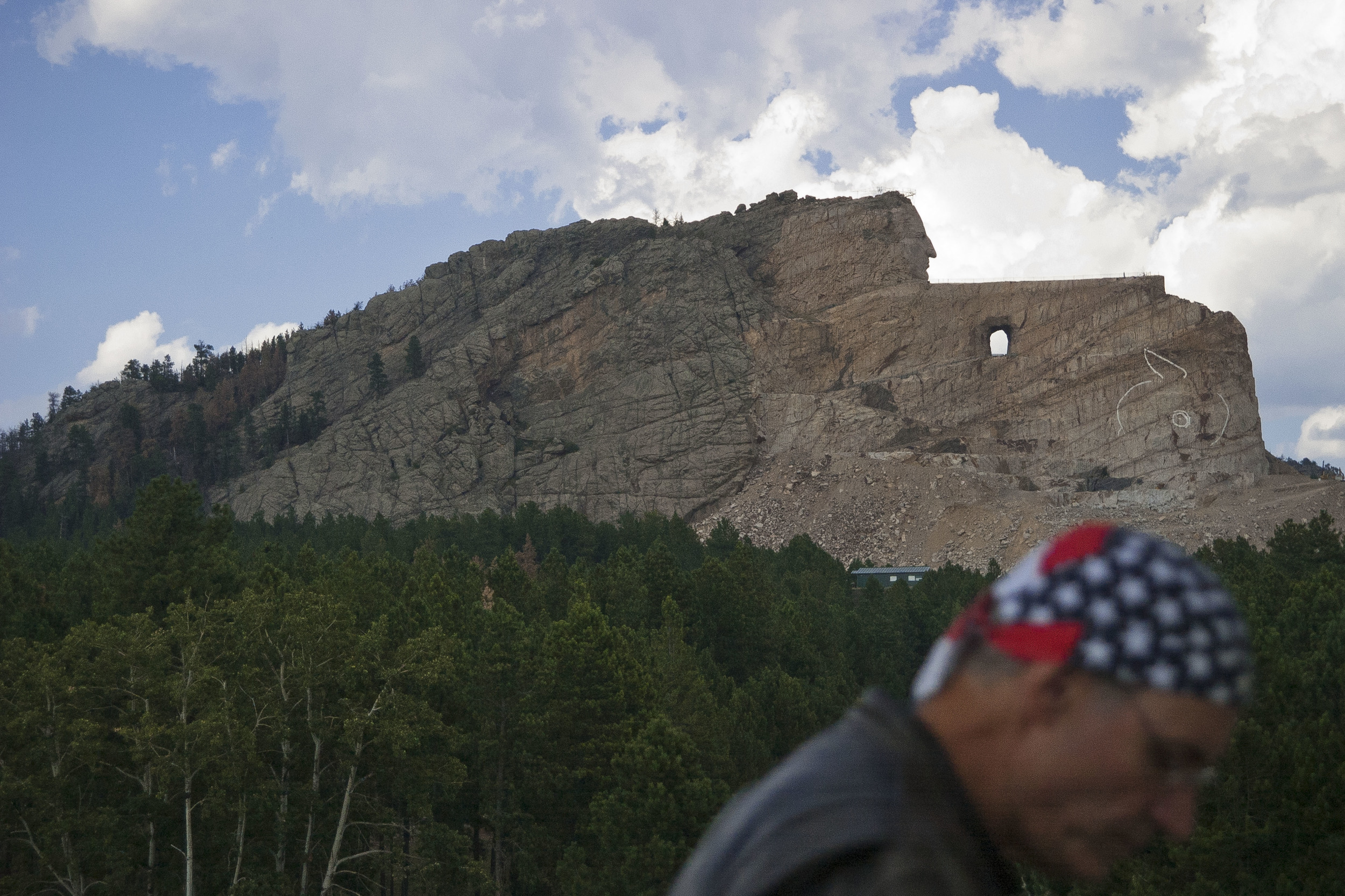 Crazy Horse monument, South Dakota. Controversy has surrounded the project since work on the massive sculpture was started in 1948. It represents the second time mountains in the black hills--holy land and burial grounds of the Sioux--have been carved out for monuments, after Mount Rushmore.