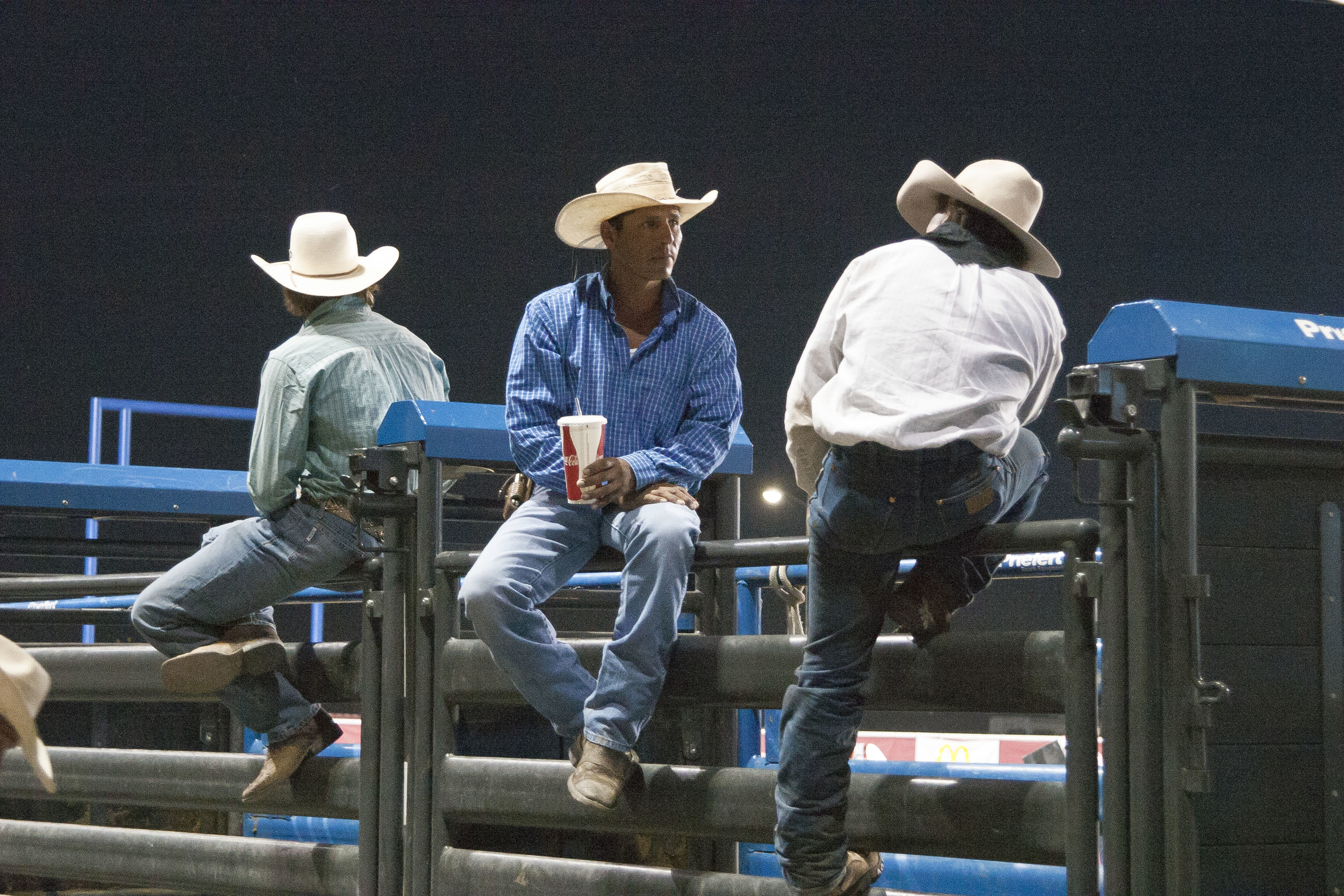 Riders converse before their events at the Cody Rodeo in Cody, Wyoming.