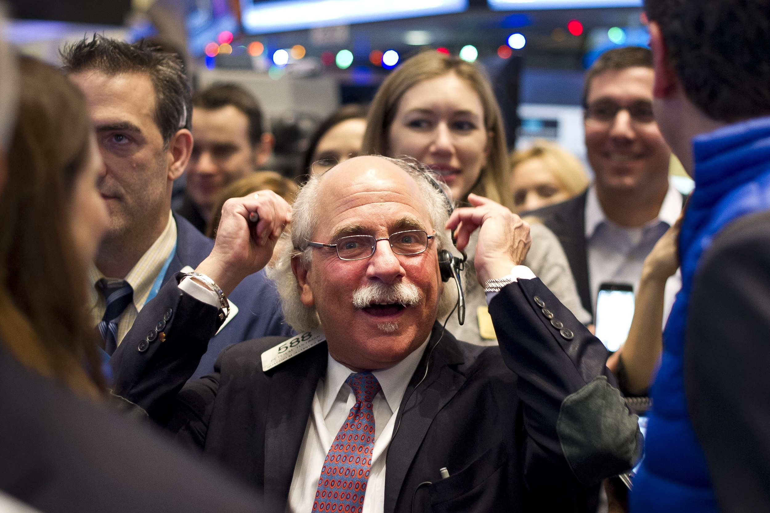 Peter Tuchman of Quattro M. Securities, Inc., jokes with OnDeck executives as the company begins its first day of trading on December 17, 2014.