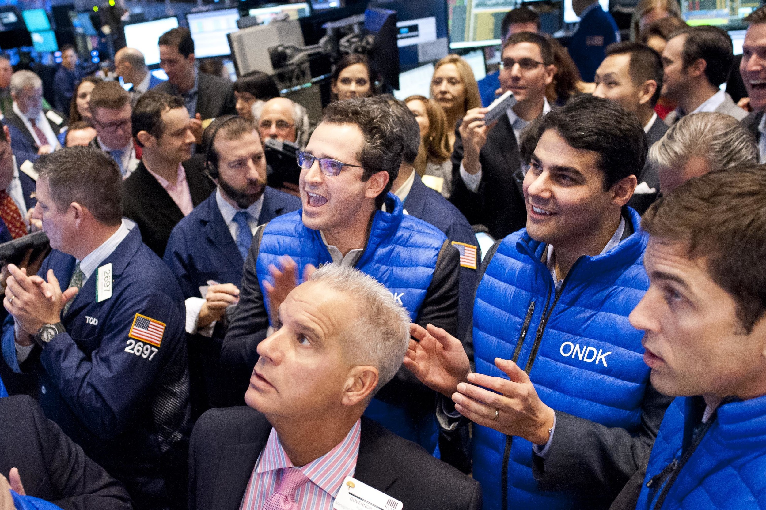 OnDeck CEO Noah Breslow (left) and CFO Howard Katzenberg (right) cheer on as their stock opens on December 17, 2014.