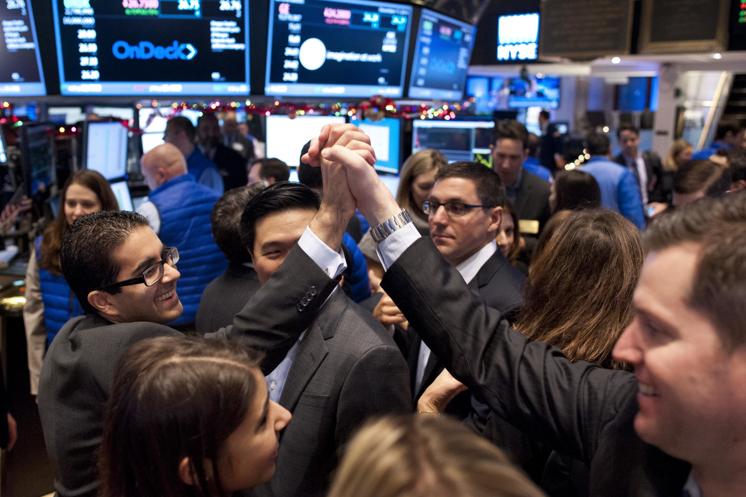 OnDeck employees celebrate as their company's stock debuts at $20.00 per share, rising to $27.98 by the end of its first day of trading.