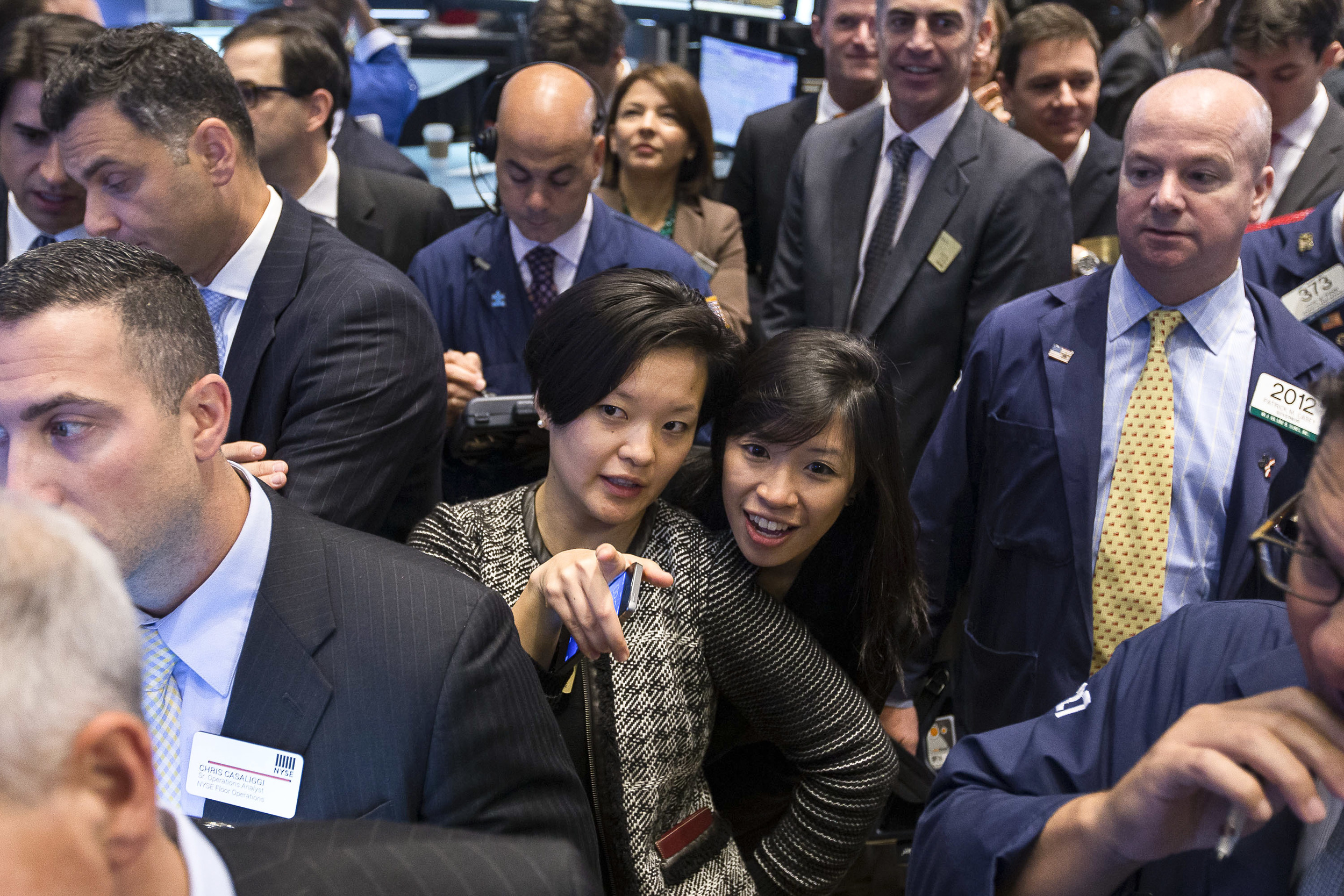 Watching the price as their company's stock opens for the first time.