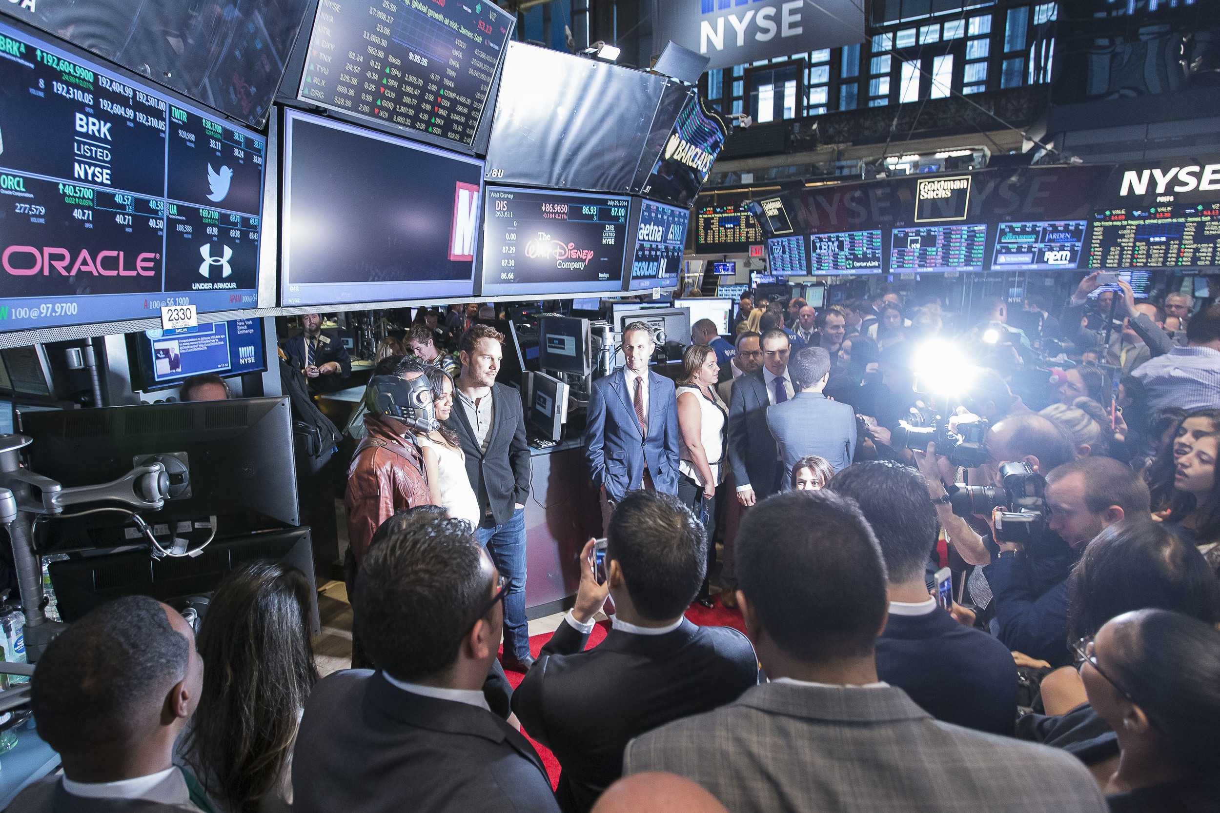 Chris Pratt and Zoe Saldana are swarmed by photographers on the trading floor as they promote Marvel's Guardians of the Galaxy movie.
