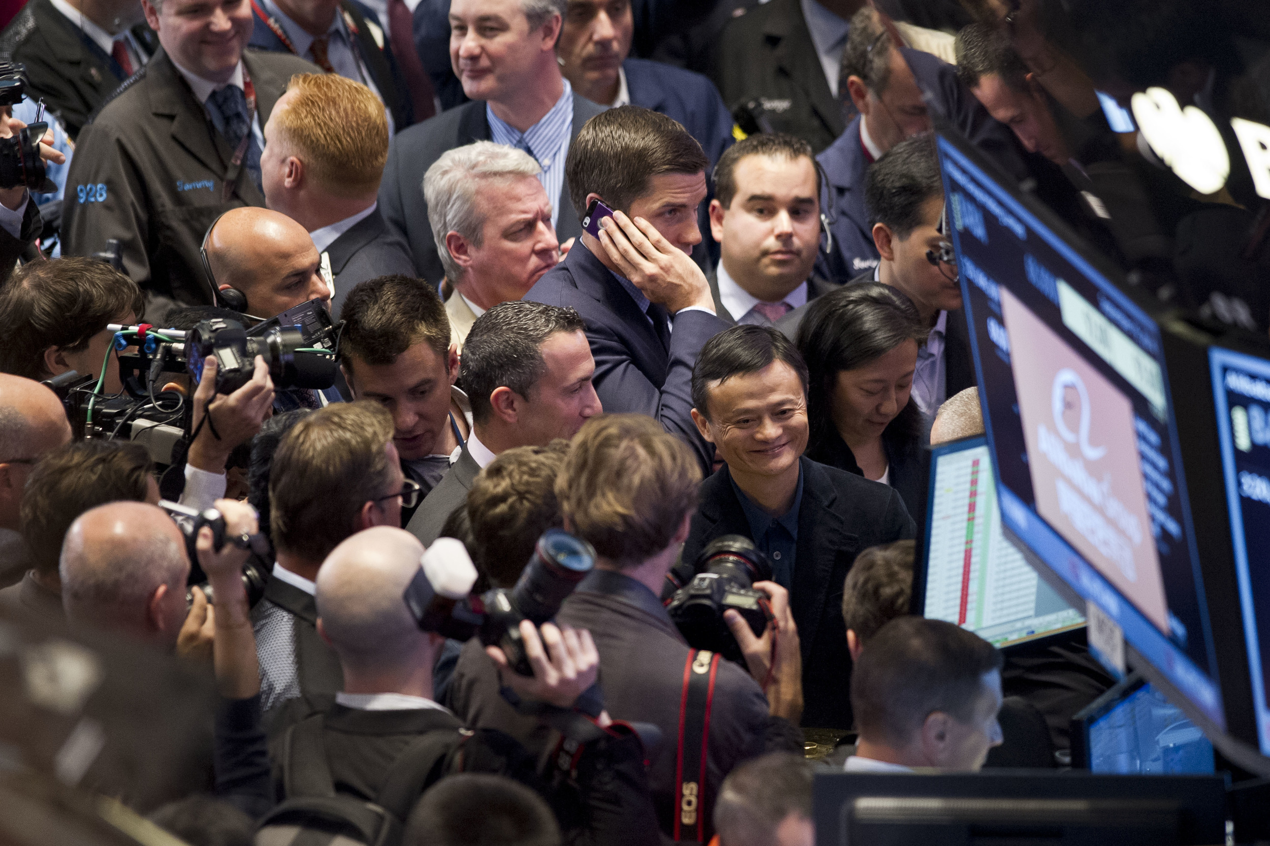 Alibaba CEO Jack Ma smiles calmly as his company brings the Exchange the largest IPO in history with an initial valuation of 25 billion USD.