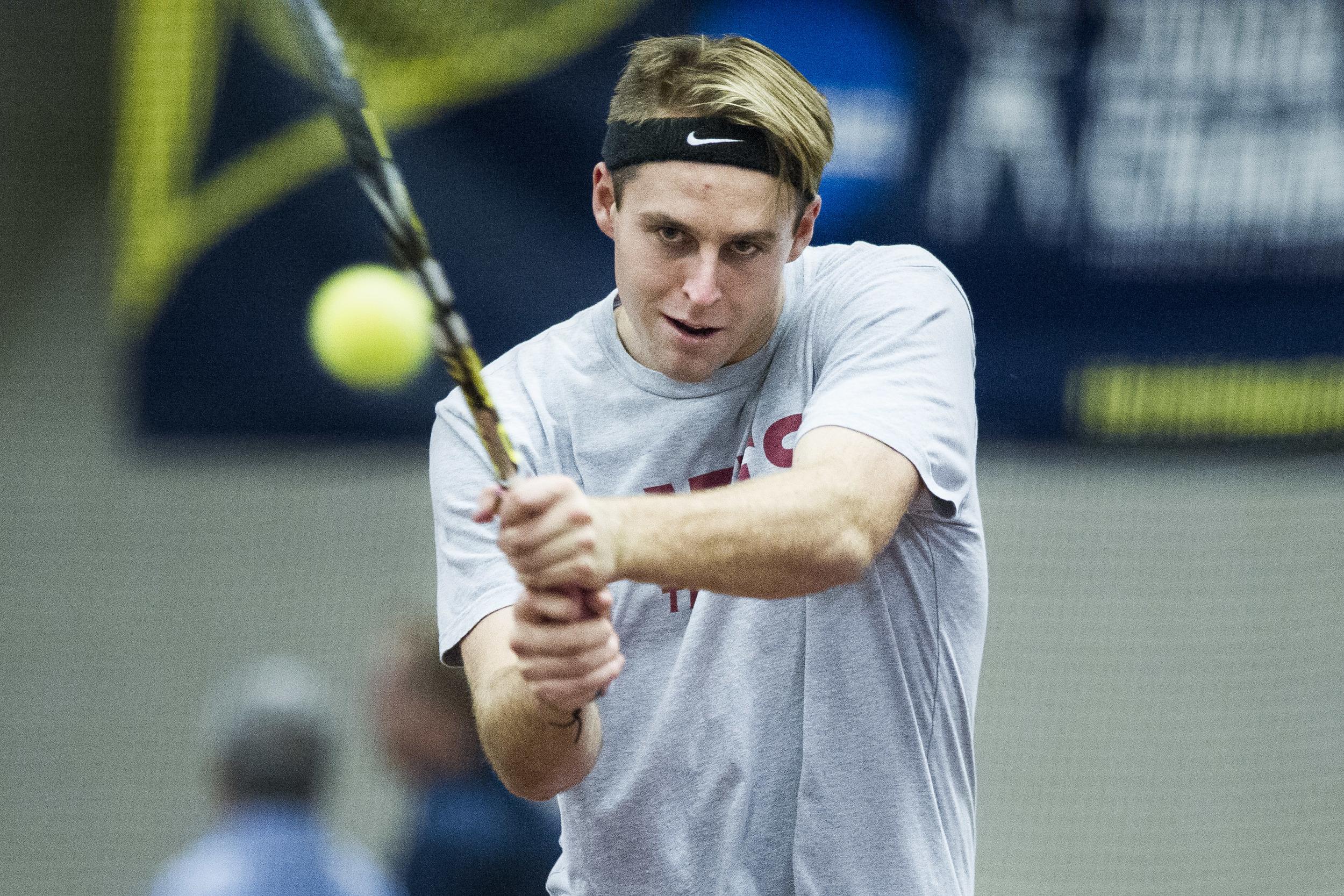 Fergus Scott '18 of Wellington, New Zealand returns a volley in practice.