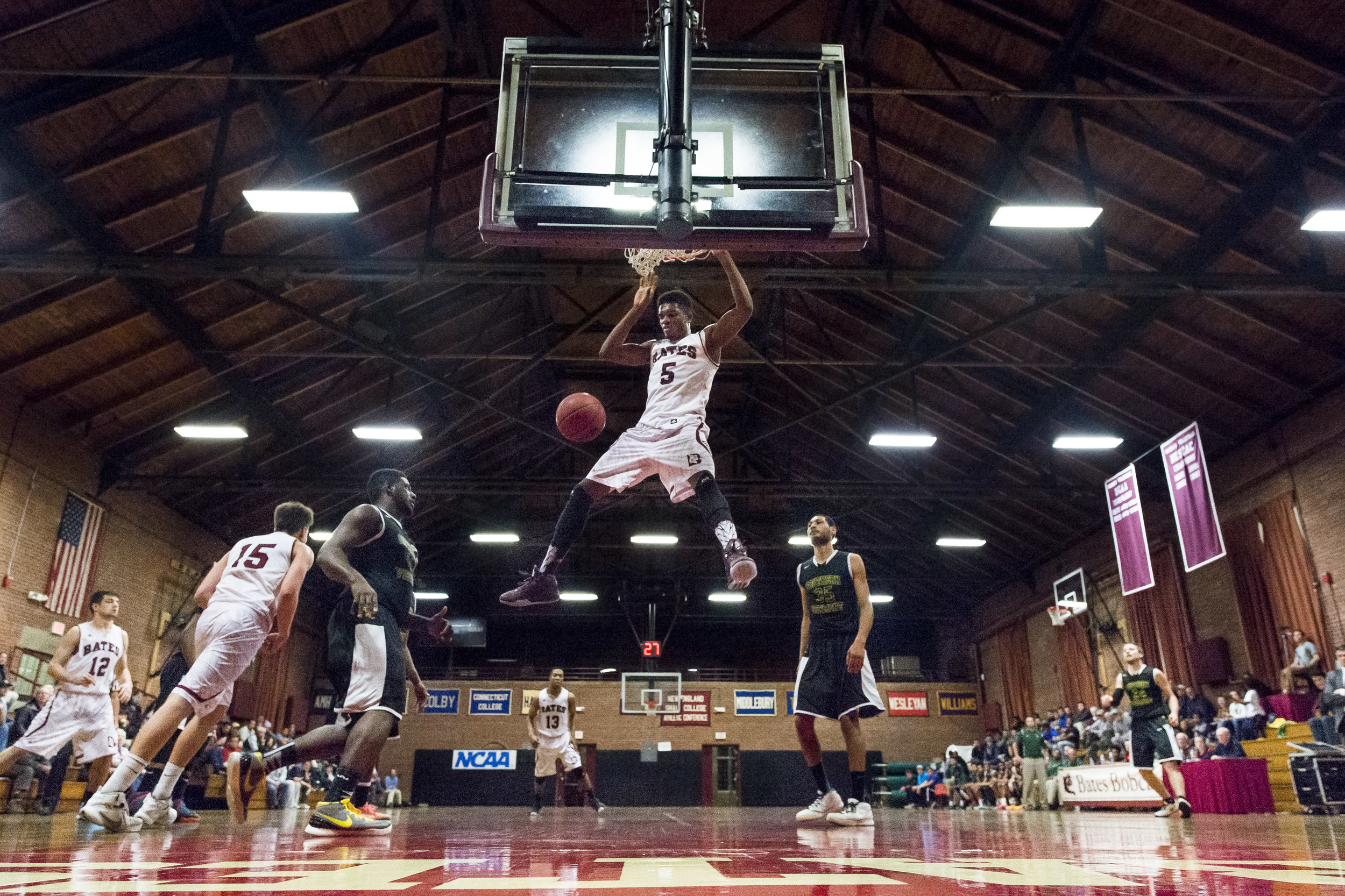 Marcus Delpeche soars for one of his four second-half dunks in Bates' 67-63 loss to Southern Vermont.