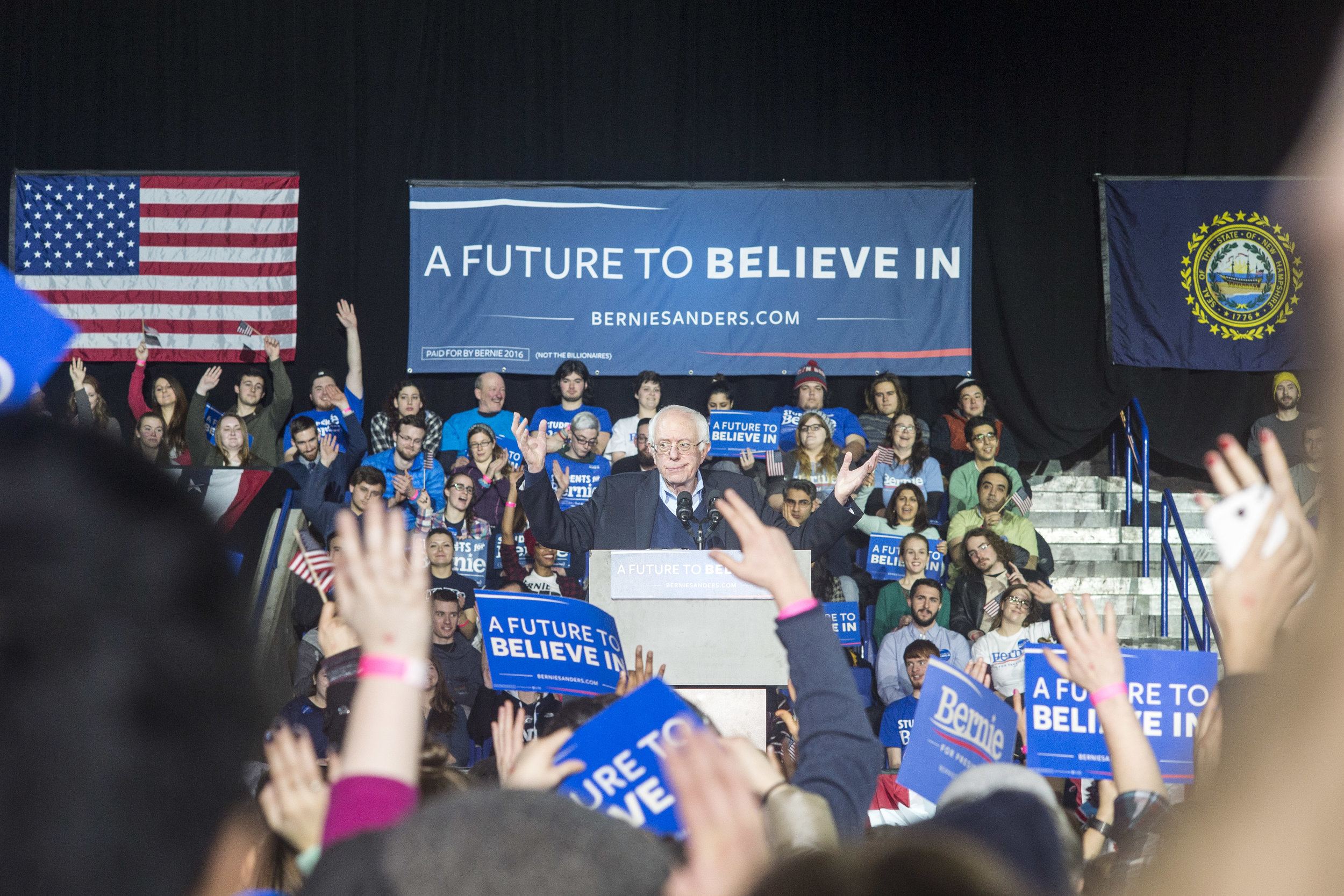 Senator Sanders raises his arms in disbelief over the specter of student debt on millenials.