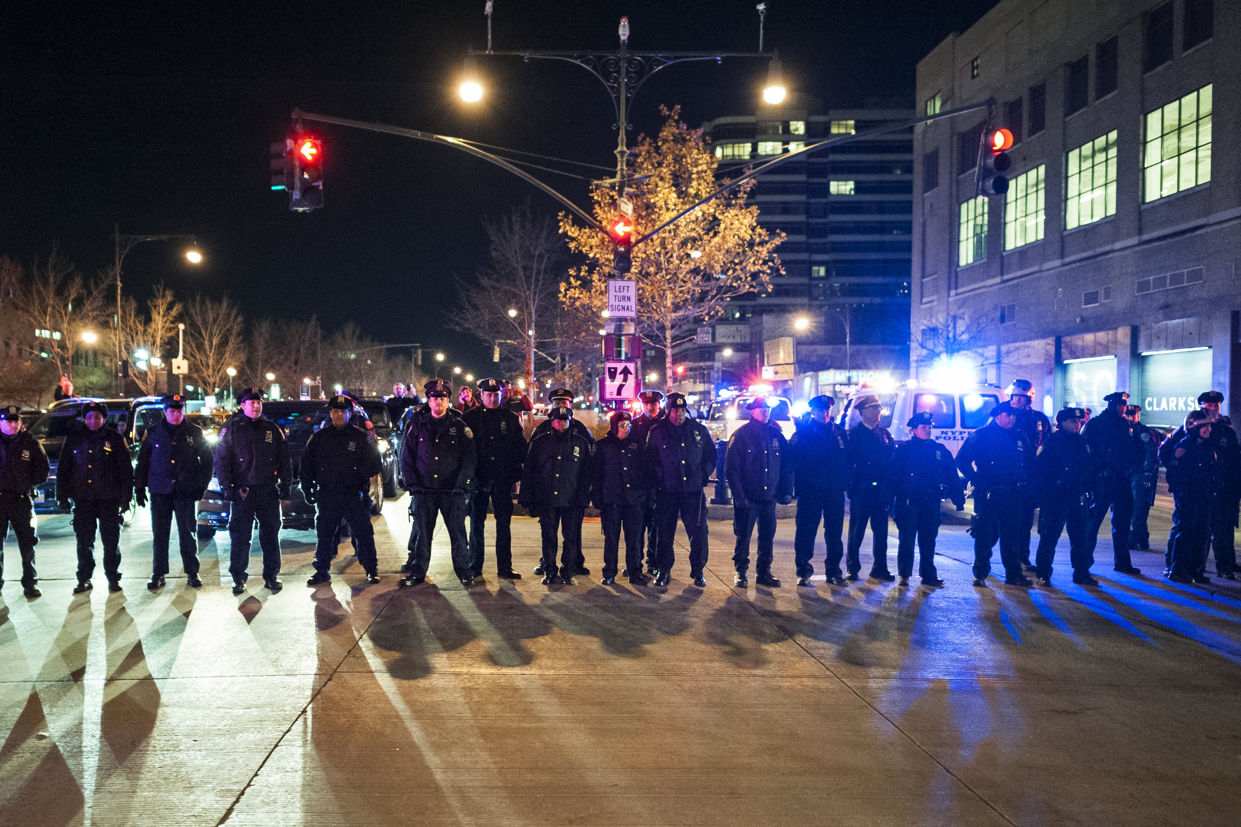 A line of police awaits an oncoming demonstration on the West Side Highway on December 4th, 2014. Weeks of protest followed a Staten Island grand jury's decision on December 3rd 2014 not to indict Officer Daniel Pantaleo in the killing of Eric Garner.