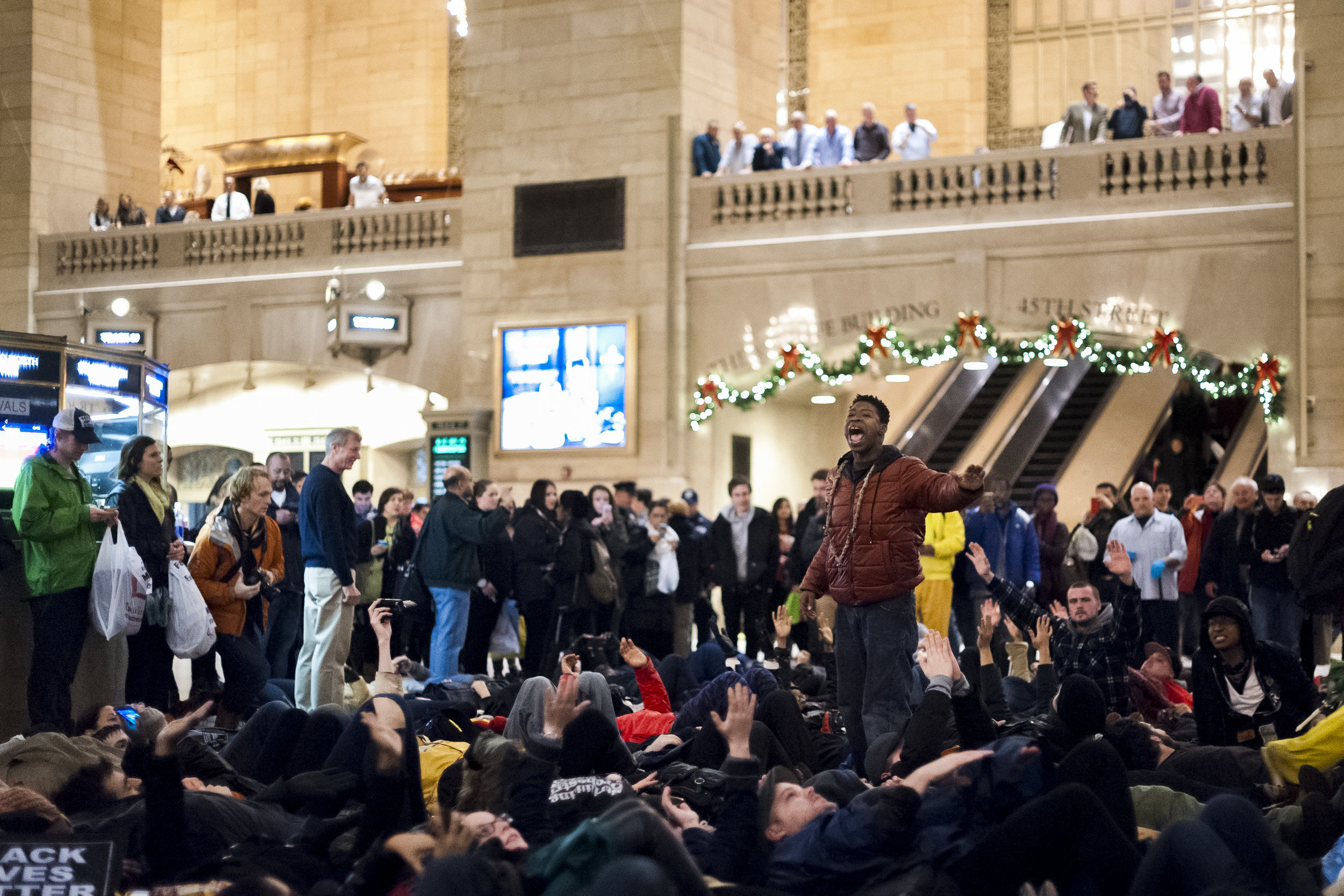 Demonstrators gather and speak in the center of the main atrium in Grand Central on December 6th, 2014. Weeks of protest followed a Staten Island grand jury's decision on December 3rd 2014 not to indict Officer Daniel Pantaleo in the killing of Eric Garner.
