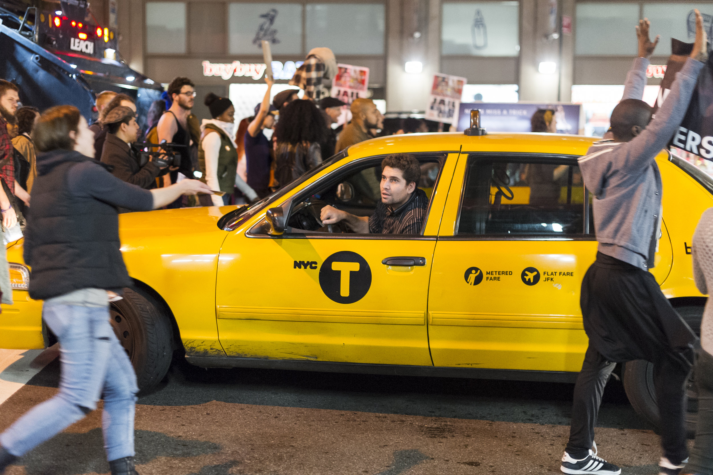 A taxi driver shouts at demonstrators as they block 7th avenue in Manhattan.