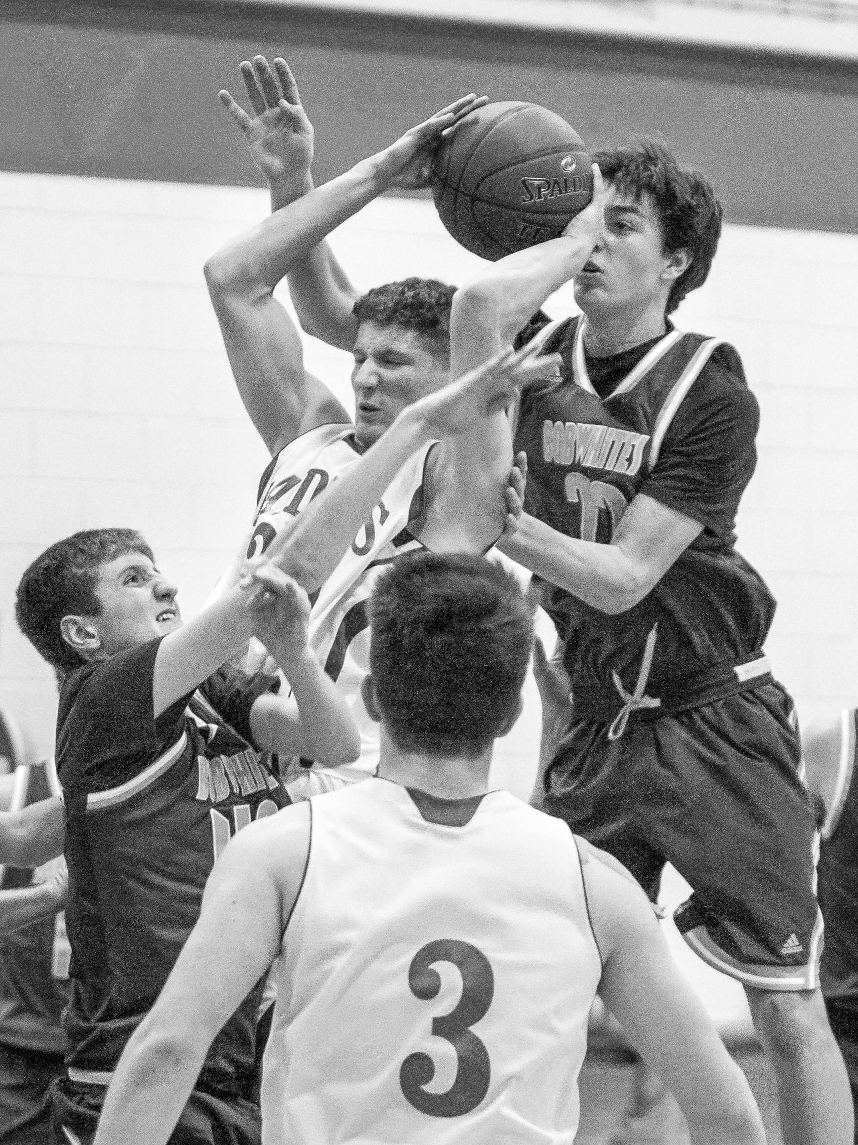 U-32's senior guard Josh Farber secures an offensive rebound through heavy traffic against visiting BFA St. Albans on Tuesday, January 9th 2018.
