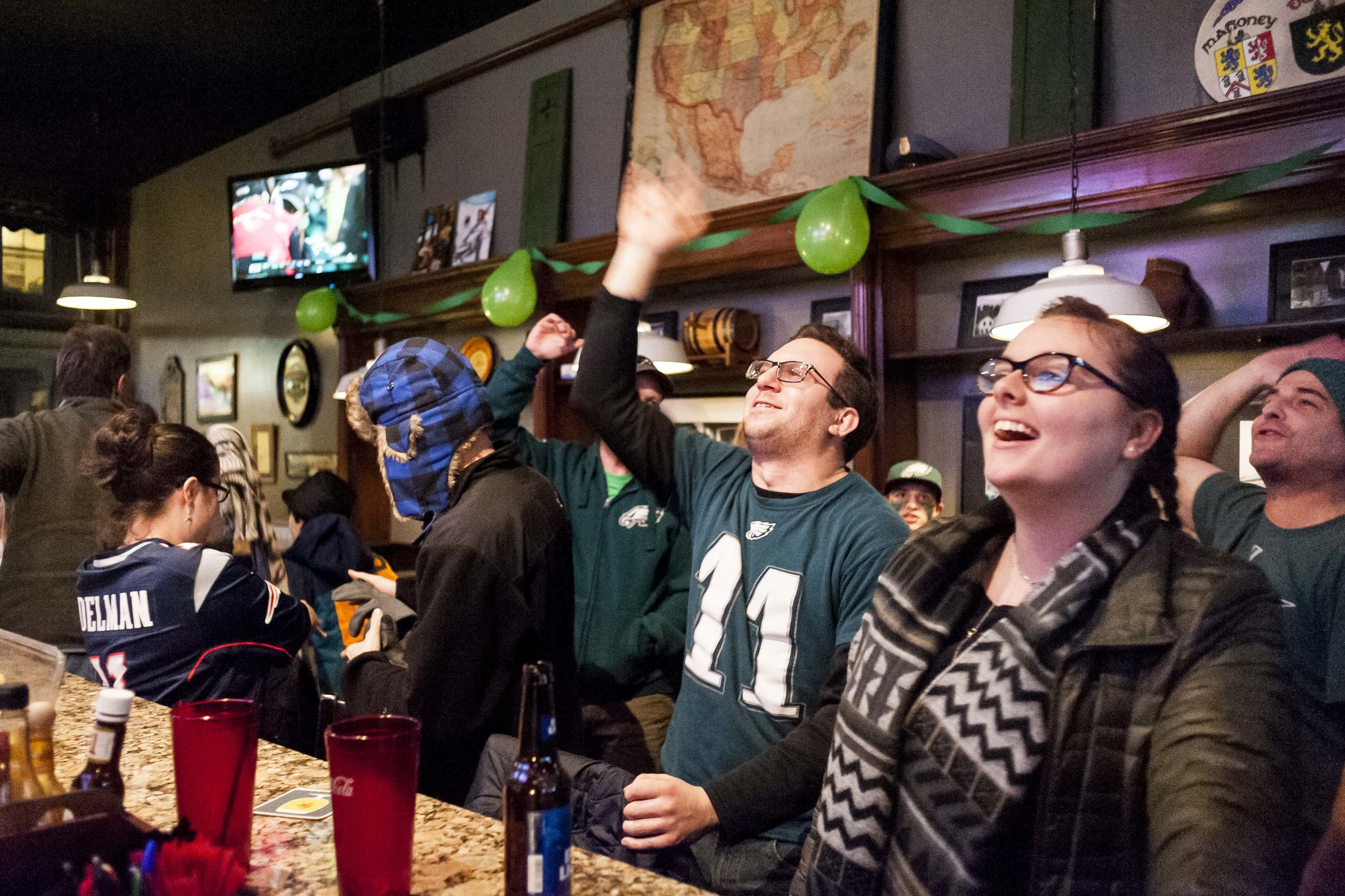 Eagles fans chant the Eagles' victory song at Langdon Street Tavern in Montpelier as Patriots fans pack up and leave following Philadelphia's first Super Bowl victory on Sunday, February 4th 2018.