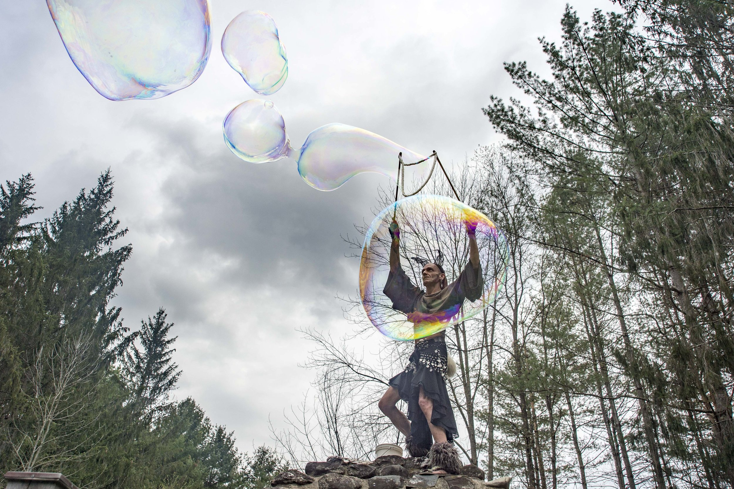 William Bridwell releases extra large bubbles into the crowd during the annual All Species Day Parade in Montpelier's Hubbard Park on May 6th, 2018.