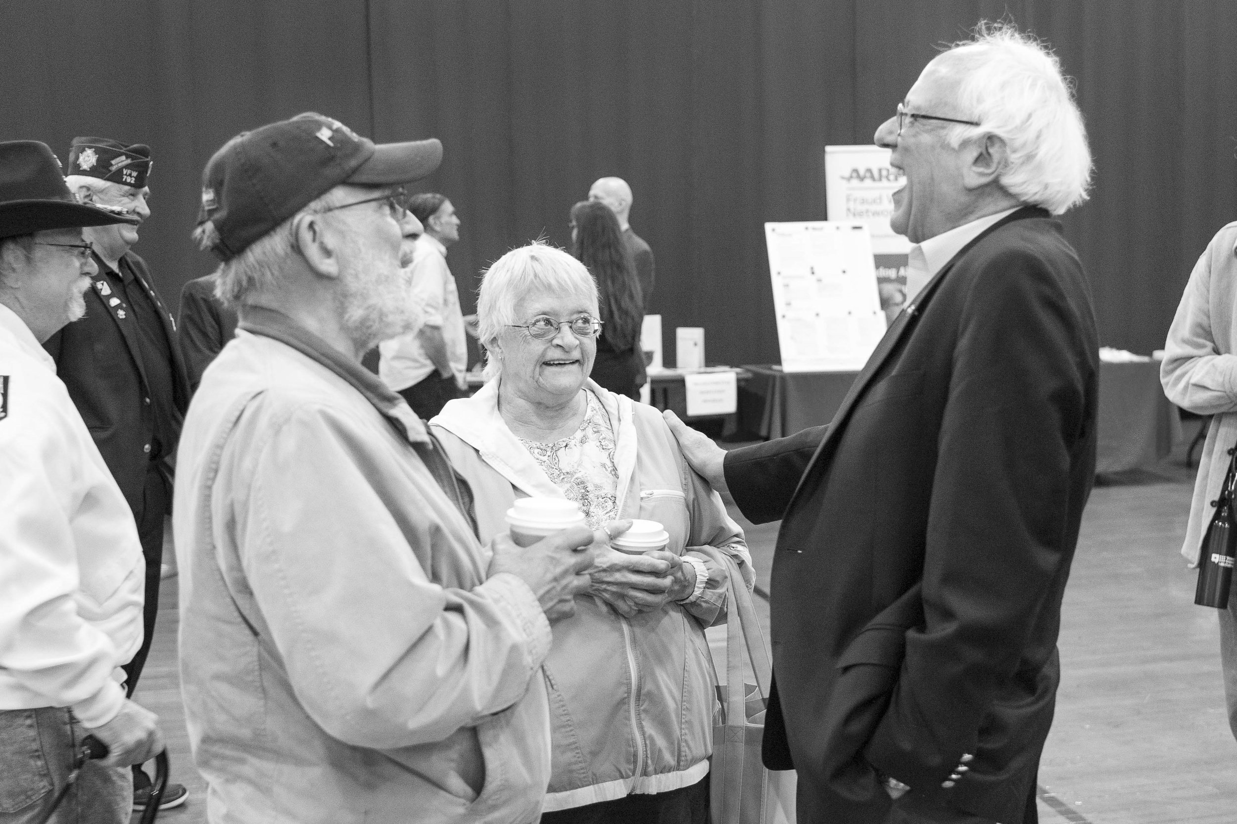 Jim and Jeanne Gricci of Northfield share a laugh with Sen. Bernie Sanders on May 19th, 2018 during a Veterans town hall and resource fair at Norwich University.