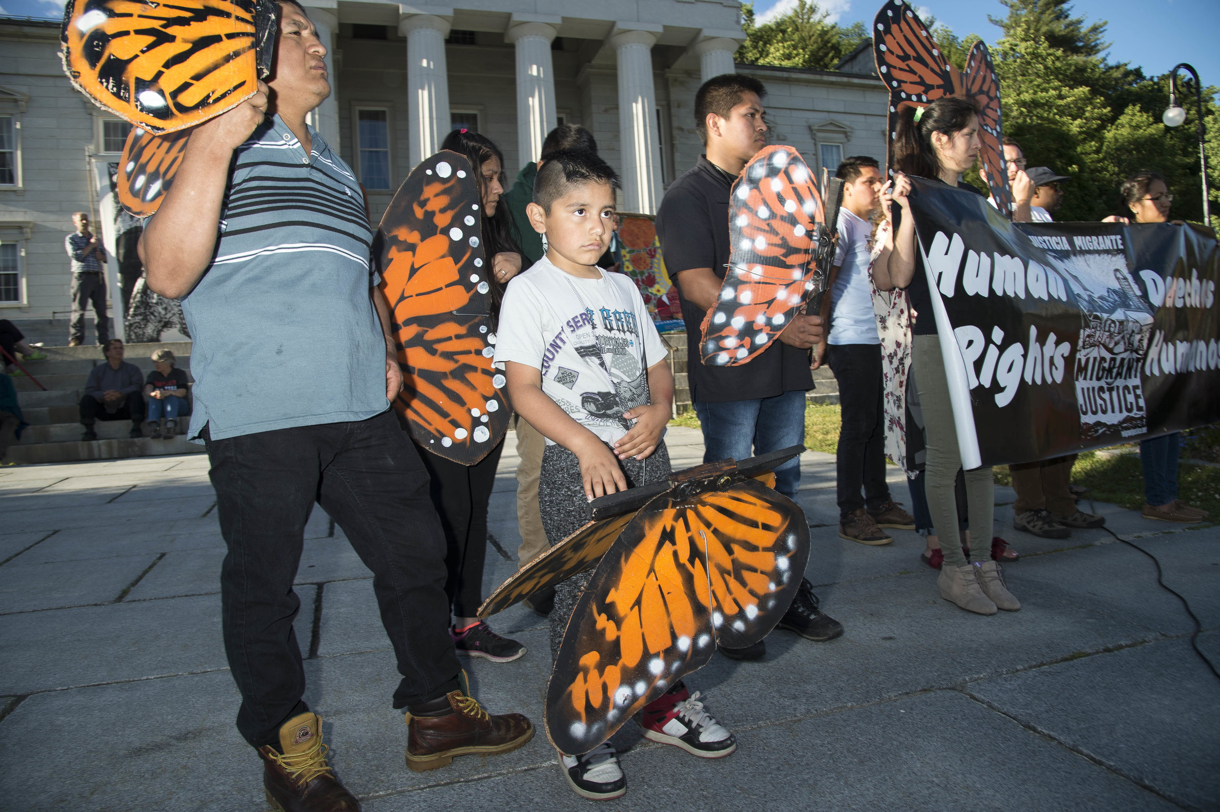 Members of Migrant Justice, a Vermont organization that advocates for migrant workers in the state join with hundreds of Vermonters in protesting U.S. Immigration policy at the State House in Montpelier on June 25th, 2018.