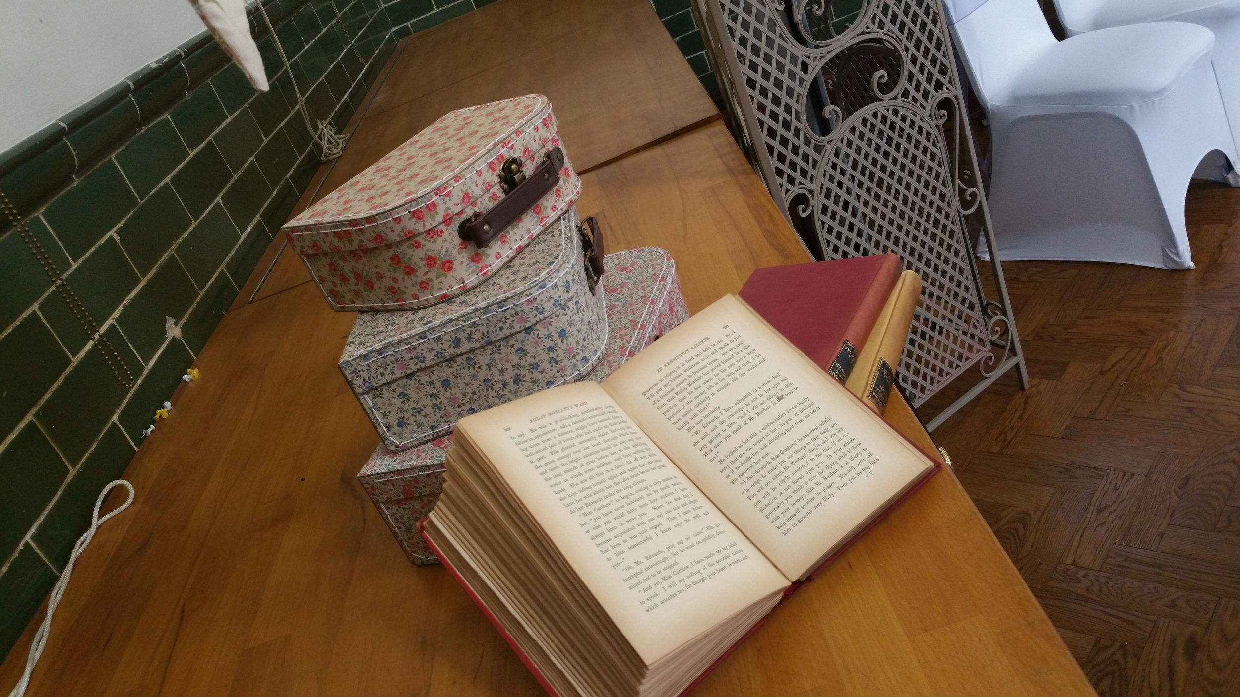 floral suitcases and vintage books add extra detail around the room