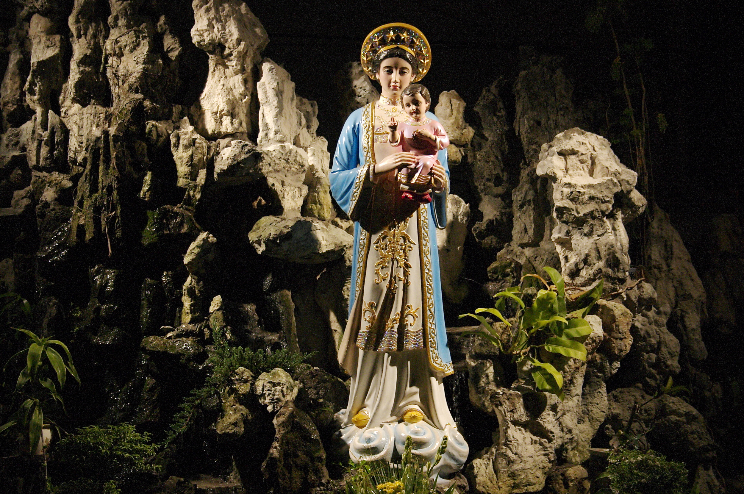 A late night walk-about through some sketchy neighborhoods and no indication of how to get home brought us to a beautiful church with this grotto of the Blessed Mother.