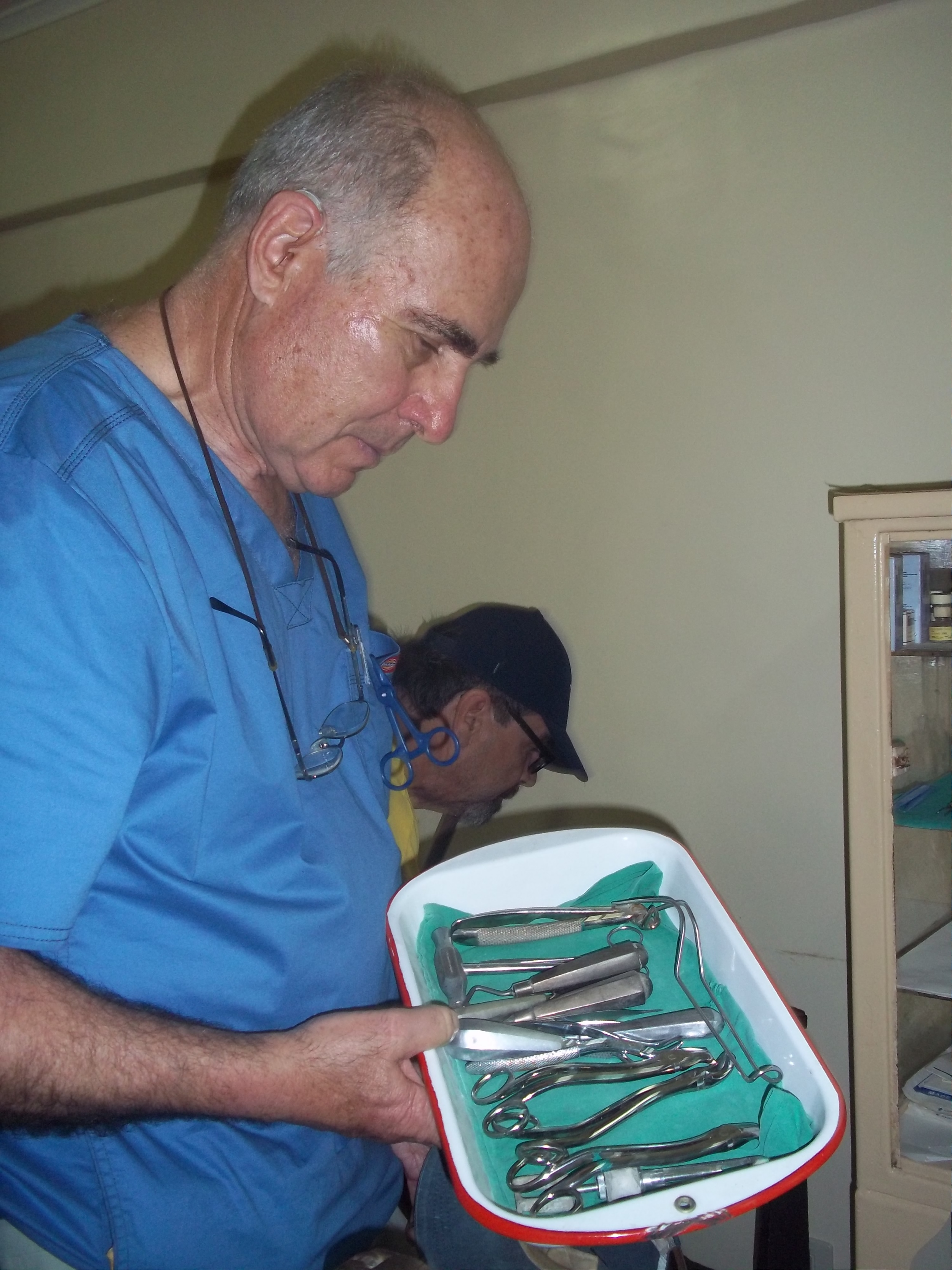 Dr. Jeffry examining unused dental supplies at the local hospital