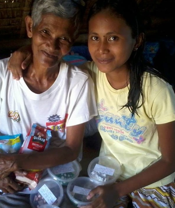 Genliza with her Grandmother and a portion of her medication regimen.