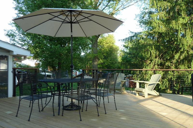 A spacious deck with plenty of room for entertaining is the perfect way to enhance the functionality of your home and take advantage of the great weather we have been having! Take a look at this deck. In particular, notice the railing - it doesn't block the view. Plus it has a durable look and feel while still creating a welcoming environment to enjoy the outdoors. Also note how there is plenty of room for entertaining or just sitting back and enjoying the sun.