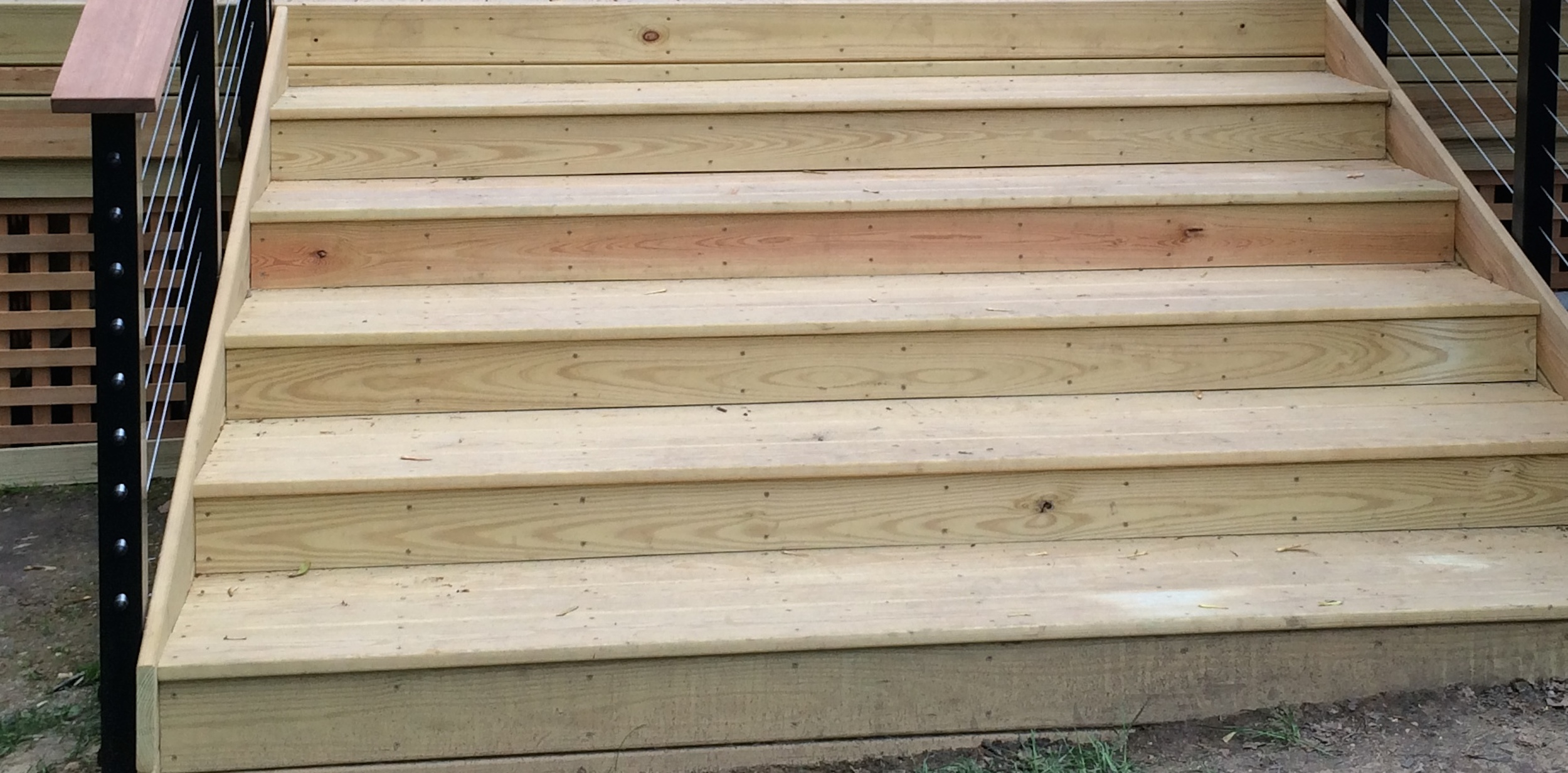 Here you see the steps up to your deck.  Note how the steps are cut to fit the slope of your yard.  Exactly what you would expect from a craftsman.