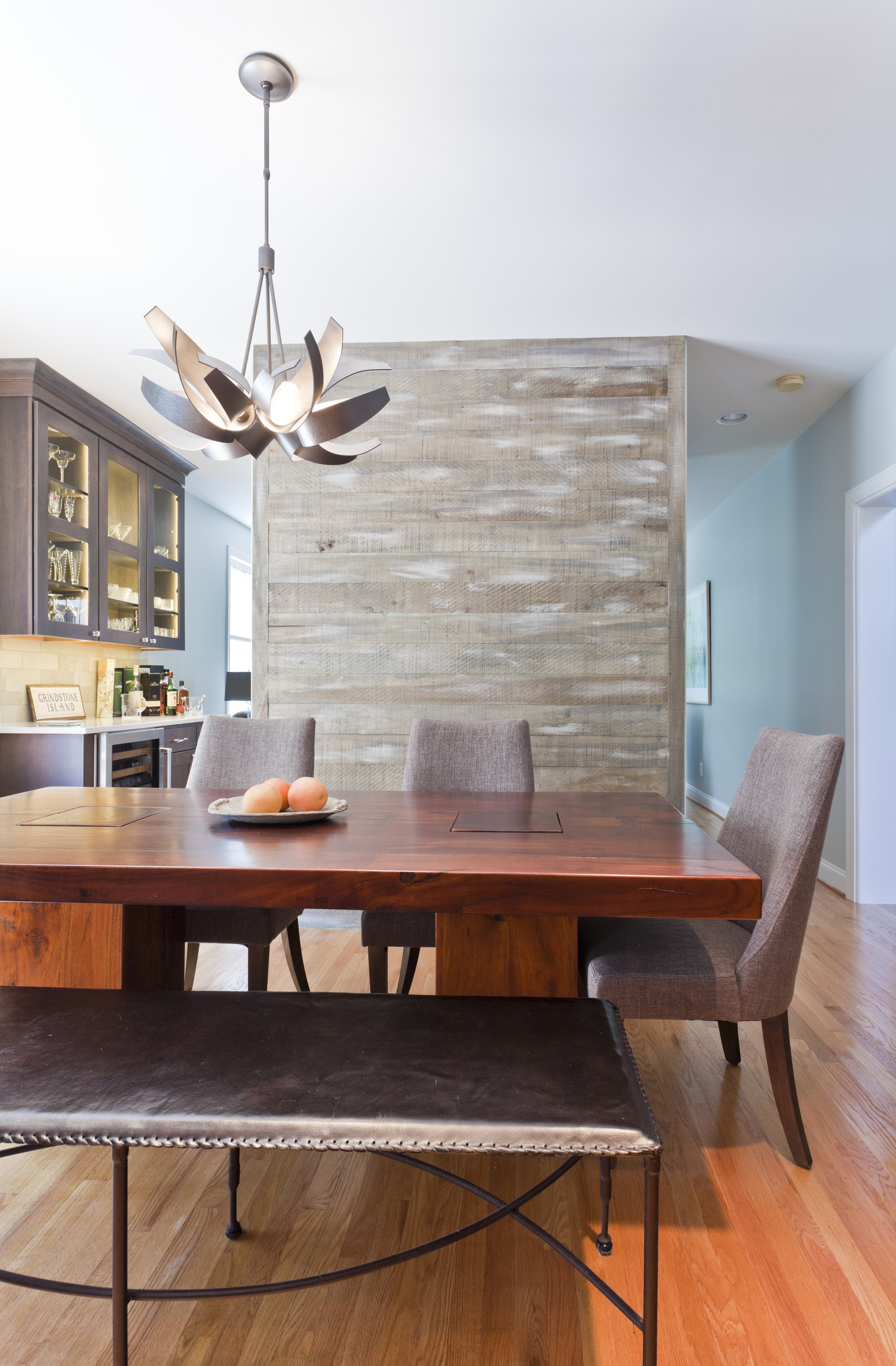 A floating wall on this side of the kitchen provides separation from the remaining space but yet keeps an open feel.