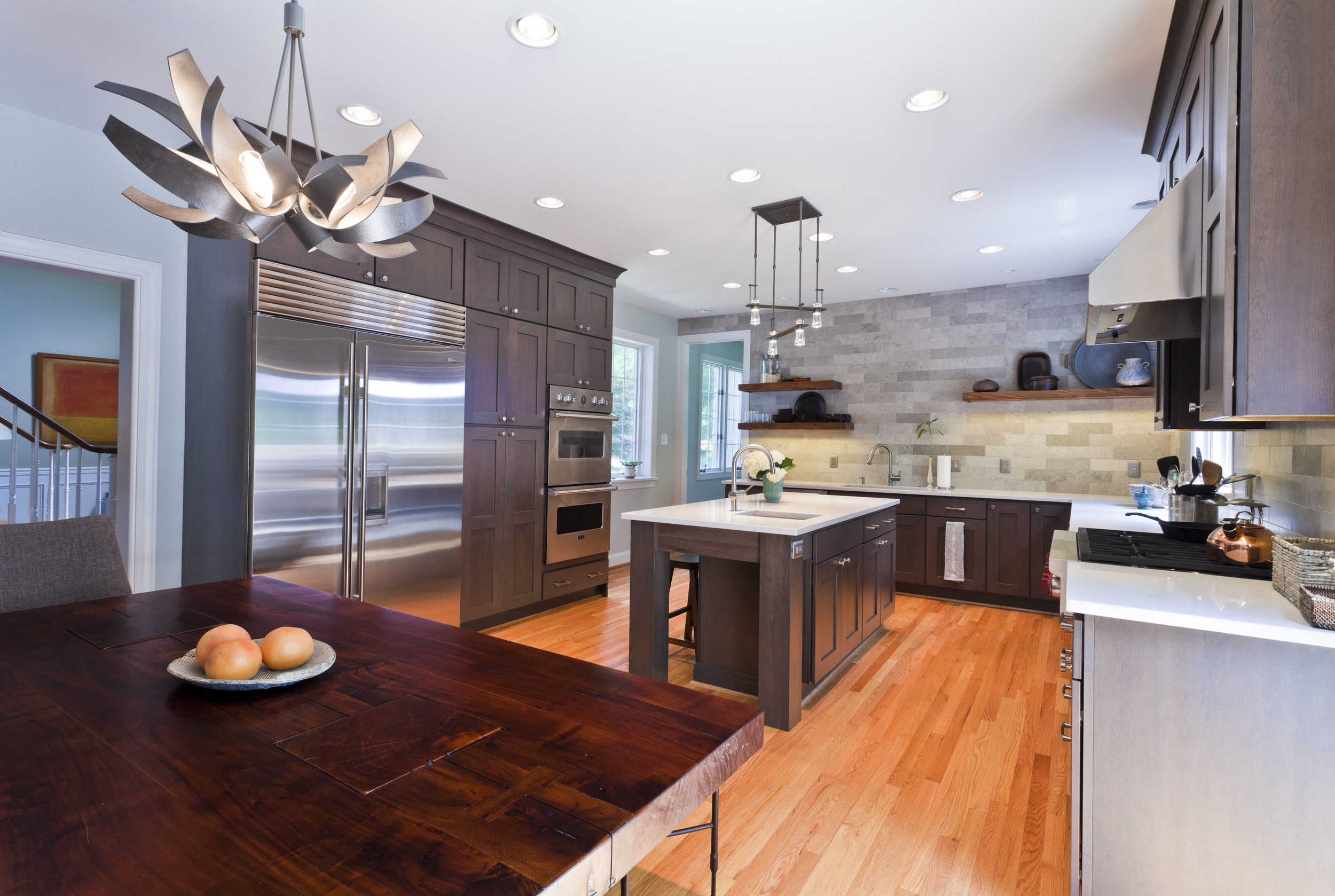 Built in appliances complete the open look to this new family gathering space. Enough room to cook and entertain!