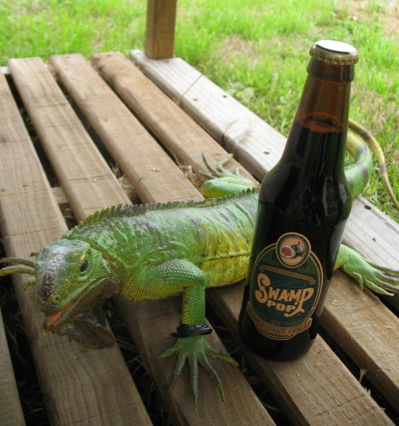 Twist on his porch enjoying a cool bottle of Swamp Pop