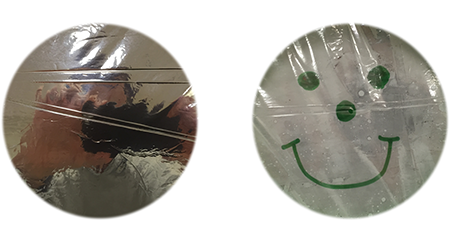 Film on left protected with SigmAlOx™ and PML Deposition. The film on right is not protected and is completely oxidized revealing the image on the backside of the film.