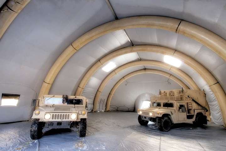 Heat reflective fabrics for insulating civilian and military shelters.