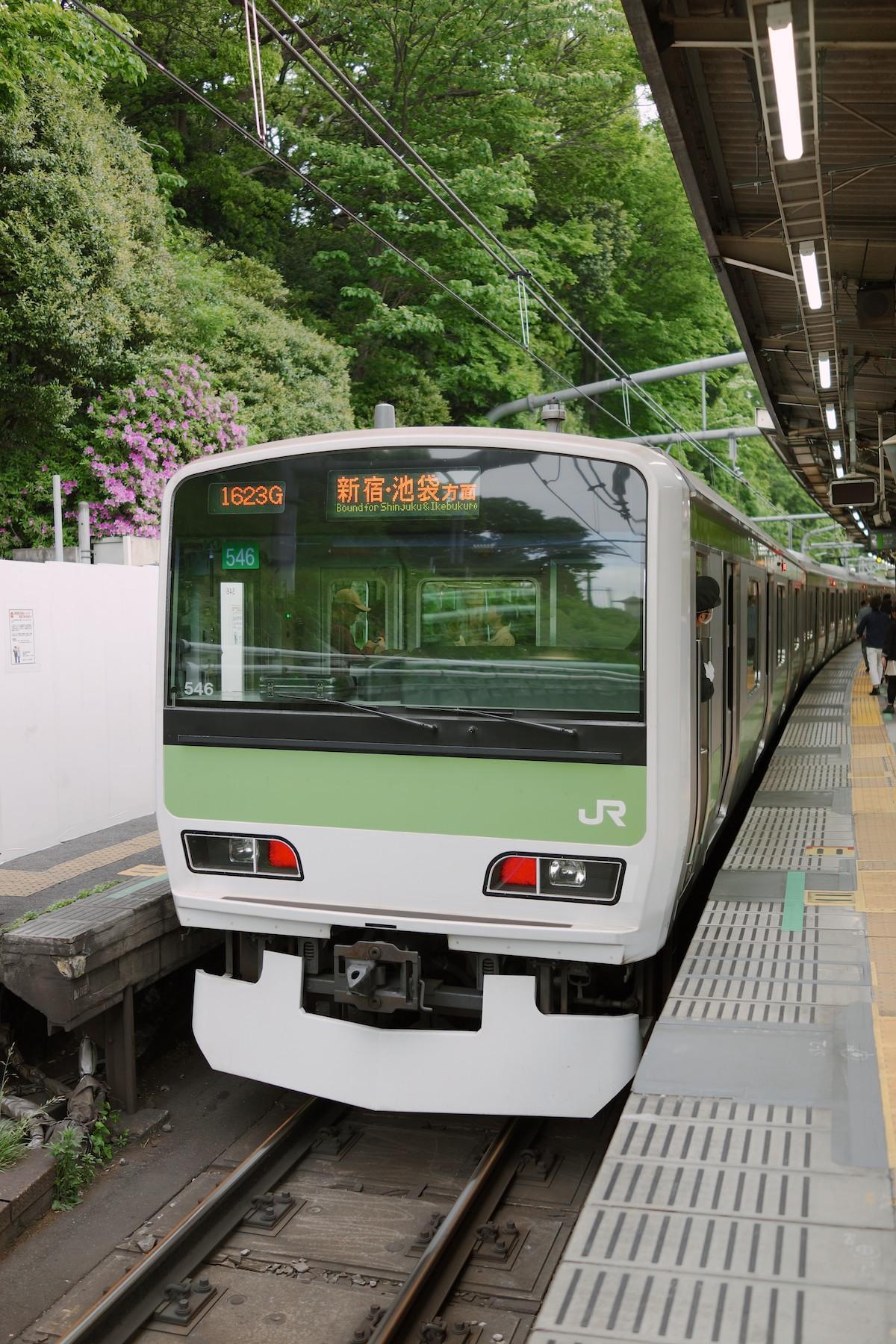A JR train stopped at Harajuku station.