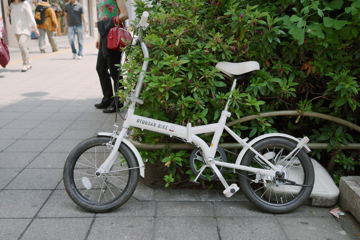 A folding bike. Otousan is the mascot for the Japanese cellular company, Softbank.