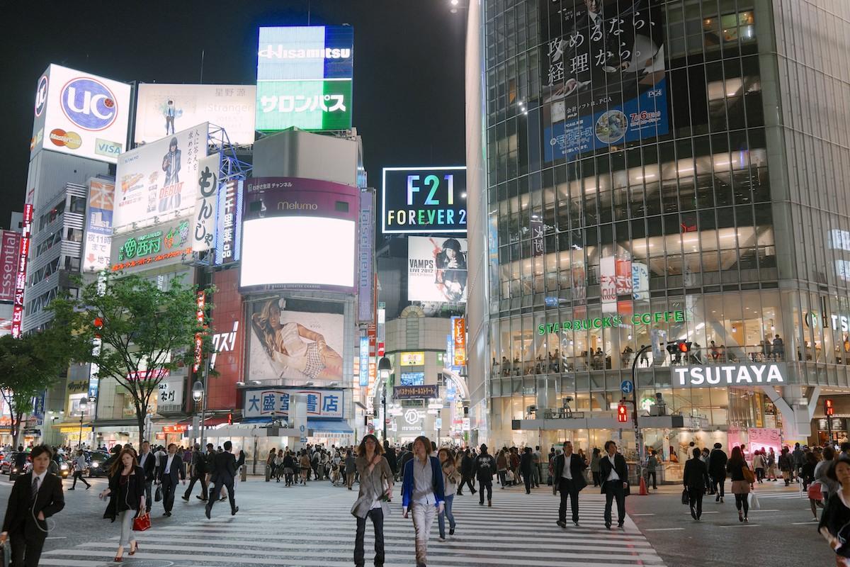 The Shibuya crossing at night.