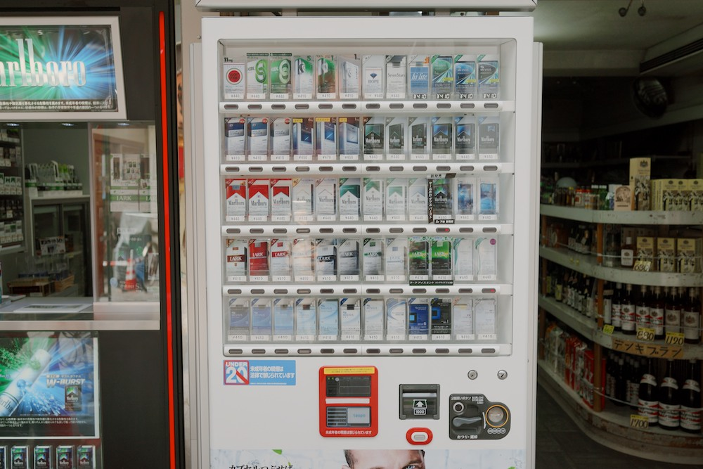 Cigarette vending machines are quite ubiquitous in Tokyo. Of course, they require identification for purchase.