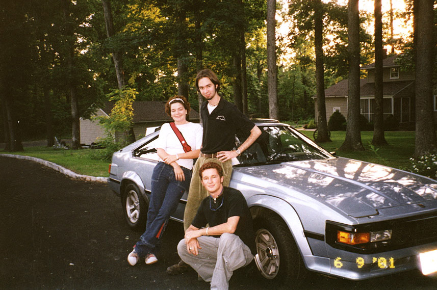 Michael and friends posing with his 1984 Toyota Supra