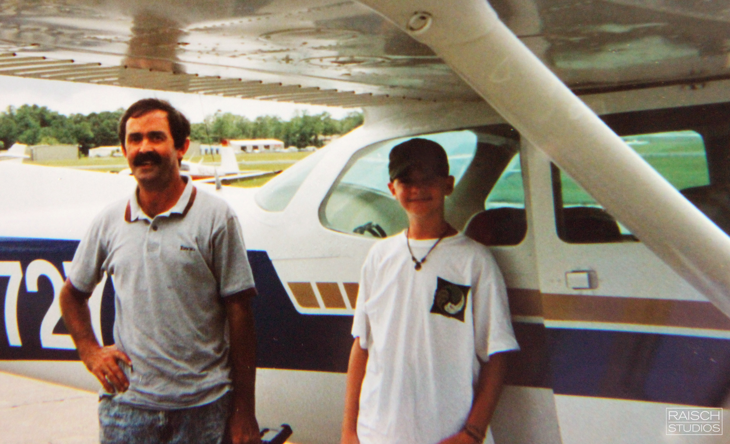 Michael and his Father after his first flight at the controls in 1995.