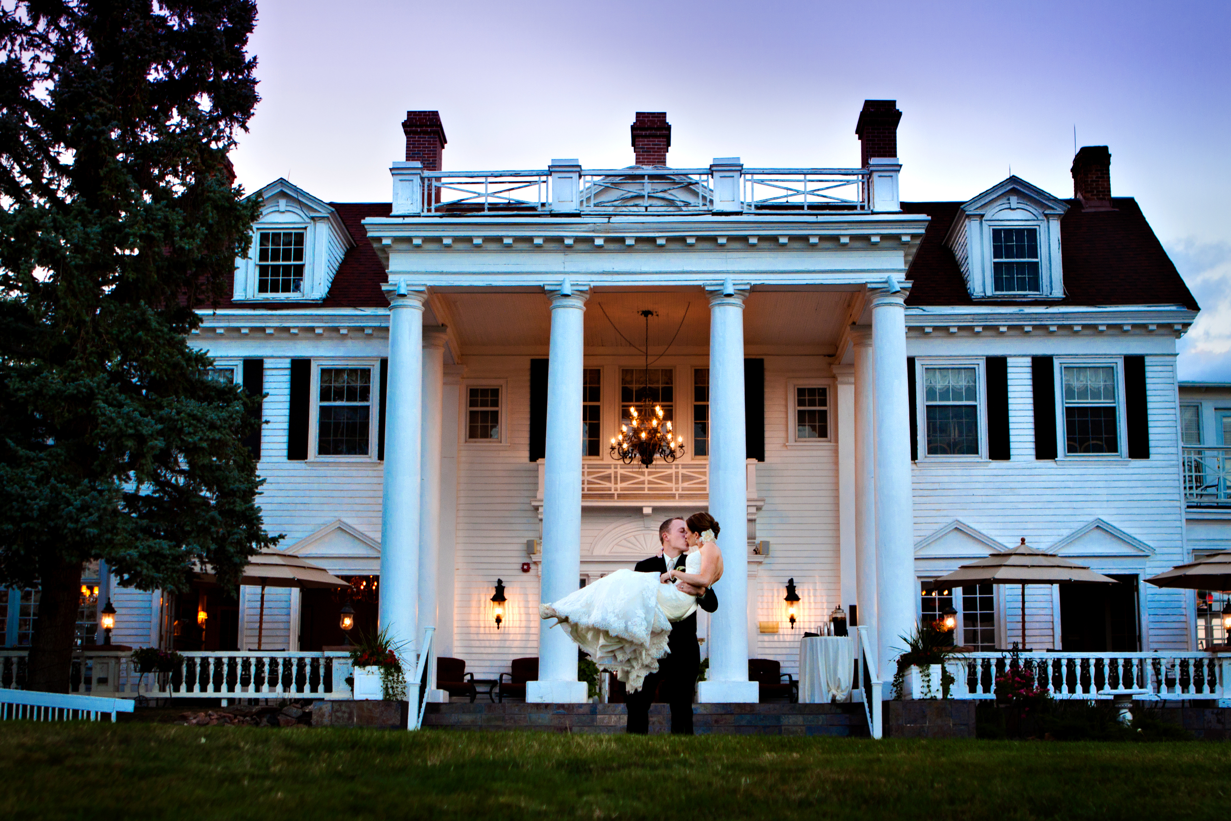 In front of the mansion, right at sunset.